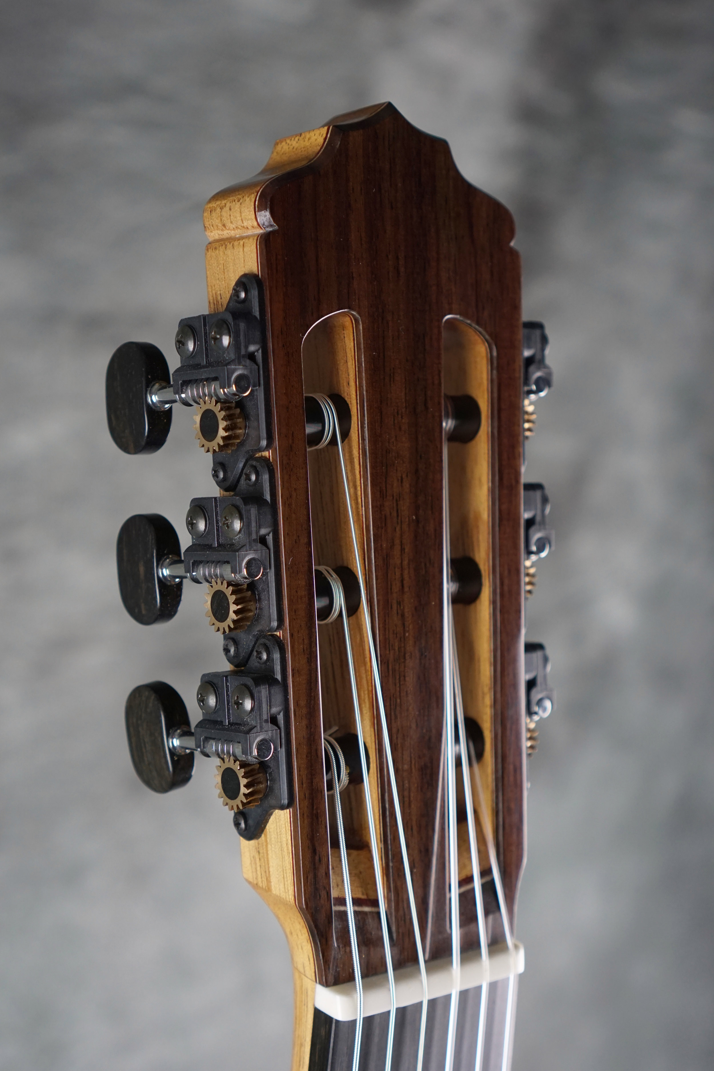 Classical guitar headstock with individual style Gilbert machines