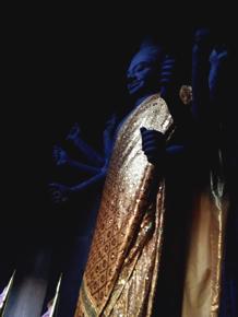 Buddha statue inside Angkor Wat dressed in Gold Cloth