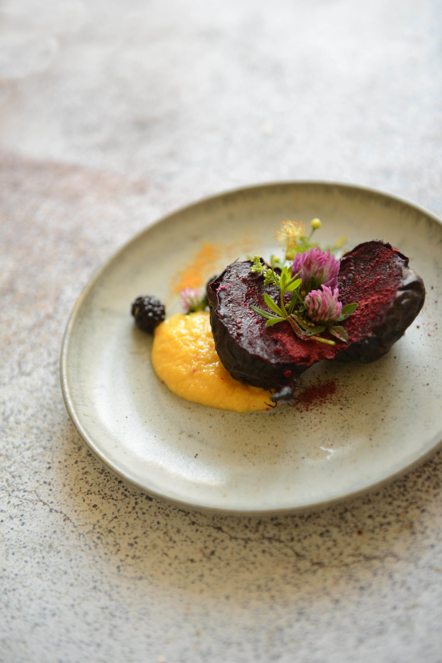 Baked beetroot, pumpkin puree, flowers and berries, orange salt