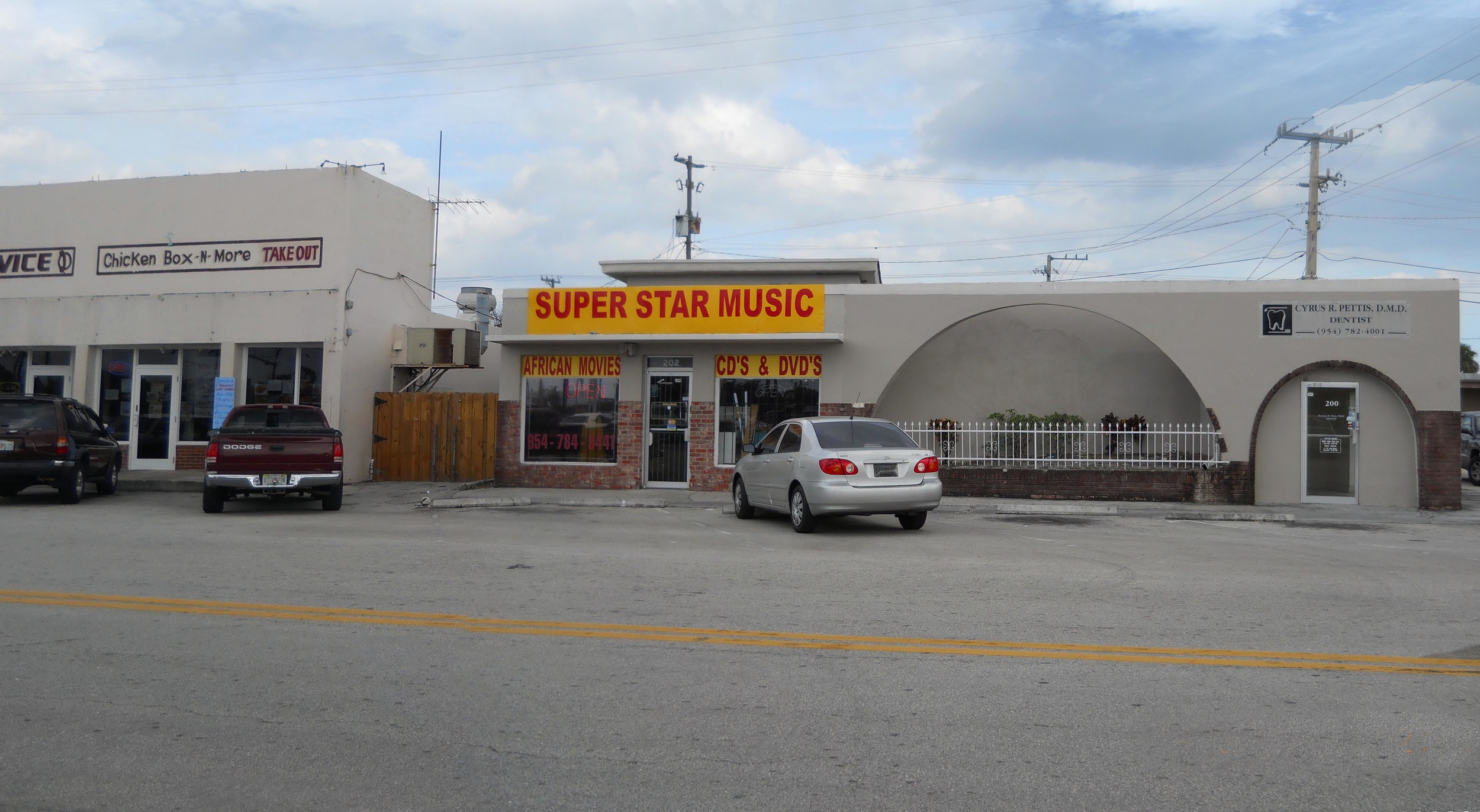 Music Store and Yellow Building Facade BEFORE.jpg