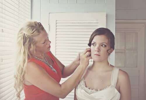 Helping my own daughter, Chloe, put her earrings on, on her wedding day! Ponte Vedra FL, 2013