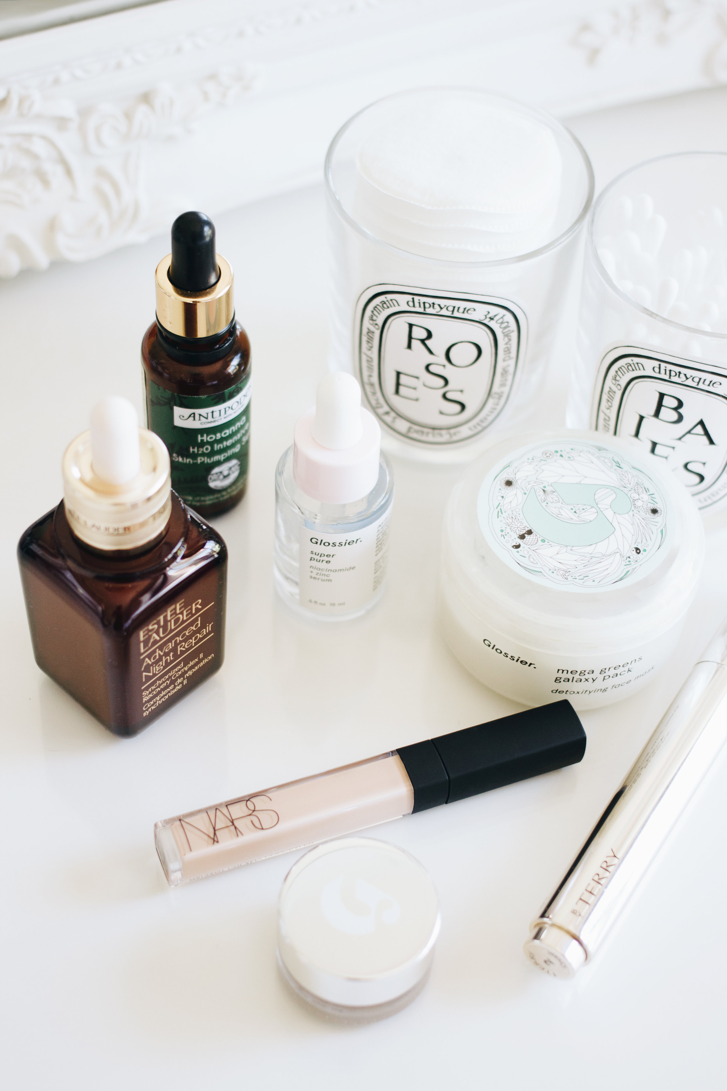 Breakouts and hyperpigmentation - Since coming off the pill six months ago (I wanted to take a little break from the hormones), breakouts and hyperpigmentation have made an unwelcome return into my life, and I've needed my skincare to diminish them as soon as possible and my makeup to disguise them as effectively as possible.Whether it's a fresh spot or a stubborn old one, I love treating my skin with the Glossier Mega Greens Galaxy Pack and upon washing it off, my skin is left feeling clean, soothed and purified. A clay-based mask made with vitamin-rich leafy greens and superfruit antioxidants, it's not at all stripping or drying and I love the fresh and clarified feeling I get after using this.For serums, Glossier Super Pure(I've unfortunately run out, but will be replacing it with The Ordinary Niacinamide 10% + Zinc 1% soon) and Estée Lauder Advanced Night Repair are my two standouts. The former's two key ingredients are niacinamide and zinc, which work to remove excess sebum and calm blemishes, and when applied at night, I wake up in the morning with my spots visibly reduced.As for the latter, this has been a part of my skincare routine going on seven years now and I can't imagine life without it. I've raved on about it a countless amount of times on my blog, but basically, it's a miracle worker for hyperpigmentation and nothing evens out my skin tone quite like it.