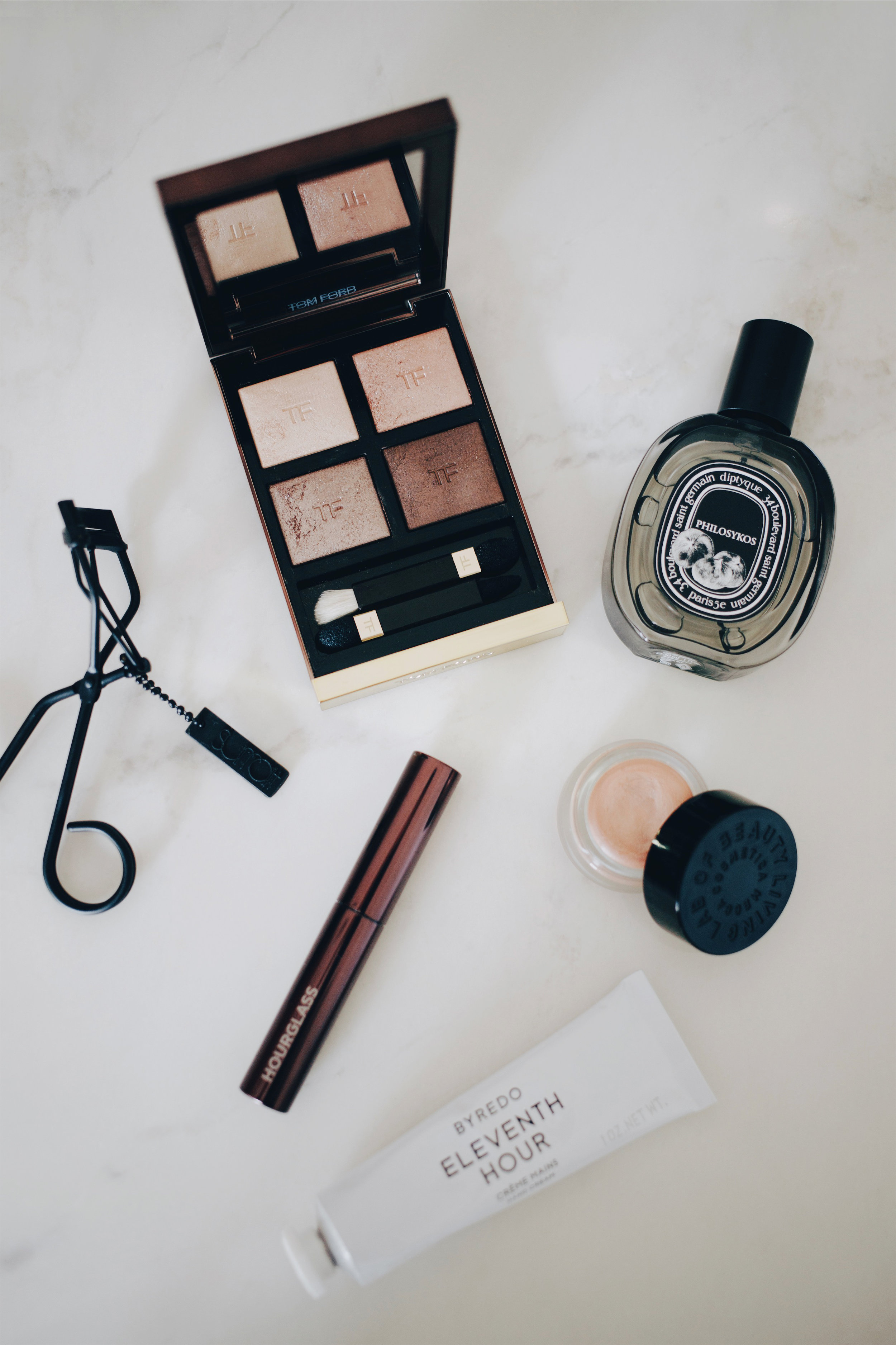 - When my old work friends ended up buying me something for my birthday that I already owned, I was left with some David Jones store credit, which I used to buy the Tom Ford Eye Colour Quad in Nude Dip. It was something I had been umm-ing and ahh-ing over buying for about three years and I figured if I was obsessing over it this much, it was worth just adding to my wishlist, and I'm definitely glad I did! The quad contains four buttery shimmer shades that when applied to the eyelids, have a slight wet-look finish that I absolutely adore. If I'm in a rush and want a quick wash of colour over the lids, I'll use the eyeshadows individually, but if I'm going for a full on eye look, I'll pair the quad with matte eyeshadows from other palettes to use in my crease, outer corner and lower lash line. I feel like some people might be put off by the fact that there are no matte shades in this quad, but because I love each individual shade in here so much, it's not an issue for me in the slightest. I've never been disappointed by Tom Ford and I really do feel like you get your money's worth with his products.When my Glossier Boy Brow ran out, I decided to see what all the fuss was about over the Hourglass Arch Brow Volumising Fibre Gel. In the shade Dark Brown, it has a dual-sided brush, which features both short and long bristles and applies the product in varying intensities. I'm more partial to the short bristles as that's what I'm used to with traditional brow gel brushes, but the long bristles are great if you like that feathery sort of look.