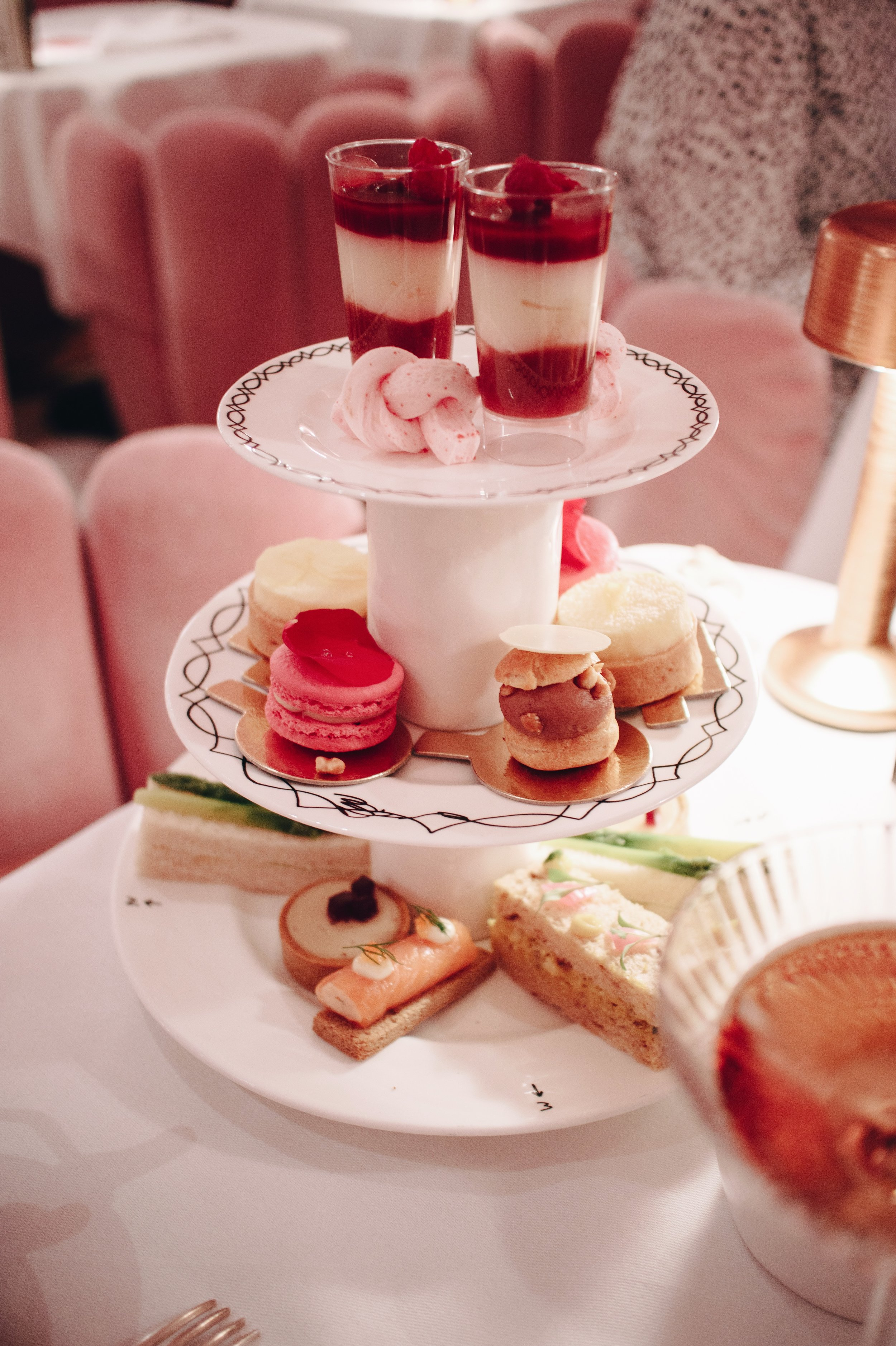 - When we arrived, we were taken to The Gallery, which is where they hold their afternoon tea. Being the lover of the colour pink that I am, my eyes naturally lit up and it was even more incredible than I imagined! The waiters were all sharply dressed, there was a man serving caviar in a pink suit and there was also a string band playing! Even the toilets were amazing! They had Diptyque candles lined up along the stairs to them and you do your business in one of these futuristic-looking pods! Very chic!There are a few different options that you can choose from on their afternoon tea menu and even the cheapest one that we chose (which was still quite expensive lol) was absolutely heavenly with so much to eat and drink! The option we went with allowed us two different teas each, so I went for some sort of fancy variation of my favourites; jasmine green tea and English breakfast. In addition to our tiered cake stand, there were a couple of other savoury dishes they brought out for us, as well as cake and scones to finish off. For how small the food is, you really don't think it would all be so filling, but by the end, I could barely get through half a scone! I definitely felt food FOMO afterwards because it was all so delicious!Our plan was to spend the rest of the afternoon shopping, but because the weather was so heinous and the atmosphere in Sketch was just so dreamy, we decided to stay put for a good few hours and make the most of our time there. It's definitely an experience to be savoured and regardless of price, I would go back in a heartbeat. I can't imagine afternoon tea getting any better than this!