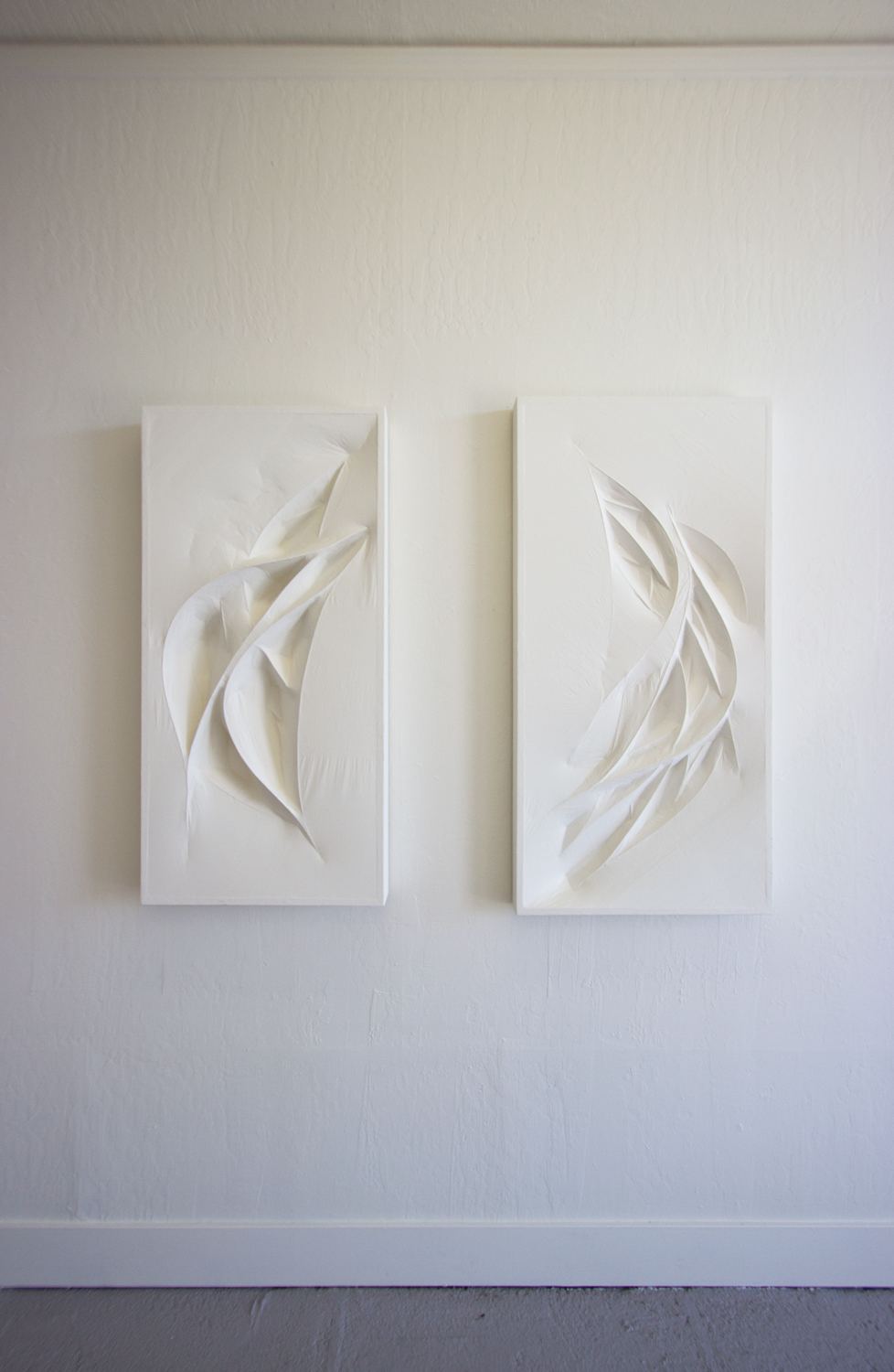 Untitled 1 & 2 (white forms)  2015  Wood panel, wood forms, and paper mache (white tracing paper with gallery white paint)  45 x 23.5 x 4 inches, 47.5 x 23.5 x 3 inches