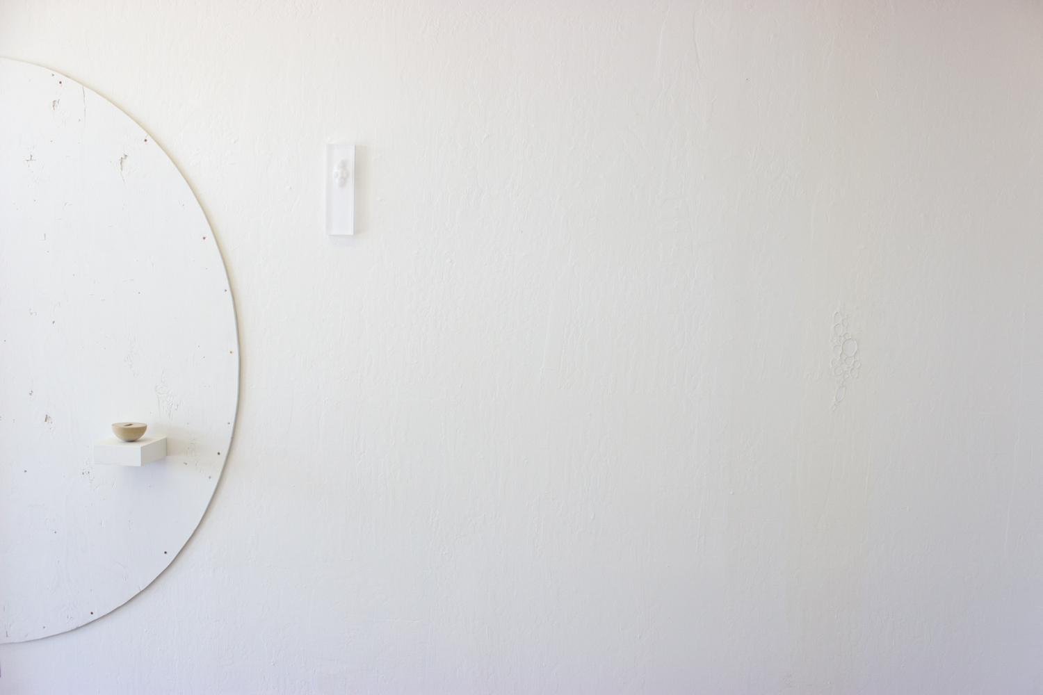 Custom Built-In   2015  Installation view (Untitled (concrete shell, half sphere),Untitled (drilled plexi), and Untitled (latex peel)shown left to right)