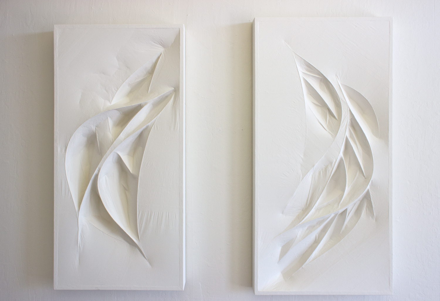 Untitled 1 & 2 (white forms)  2015  Wood panel, wood forms, and paper mache (white tracing paper with gallery white paint)  45 x 23.5 x 4 inches,47.5 x 23.5 x 3 inches