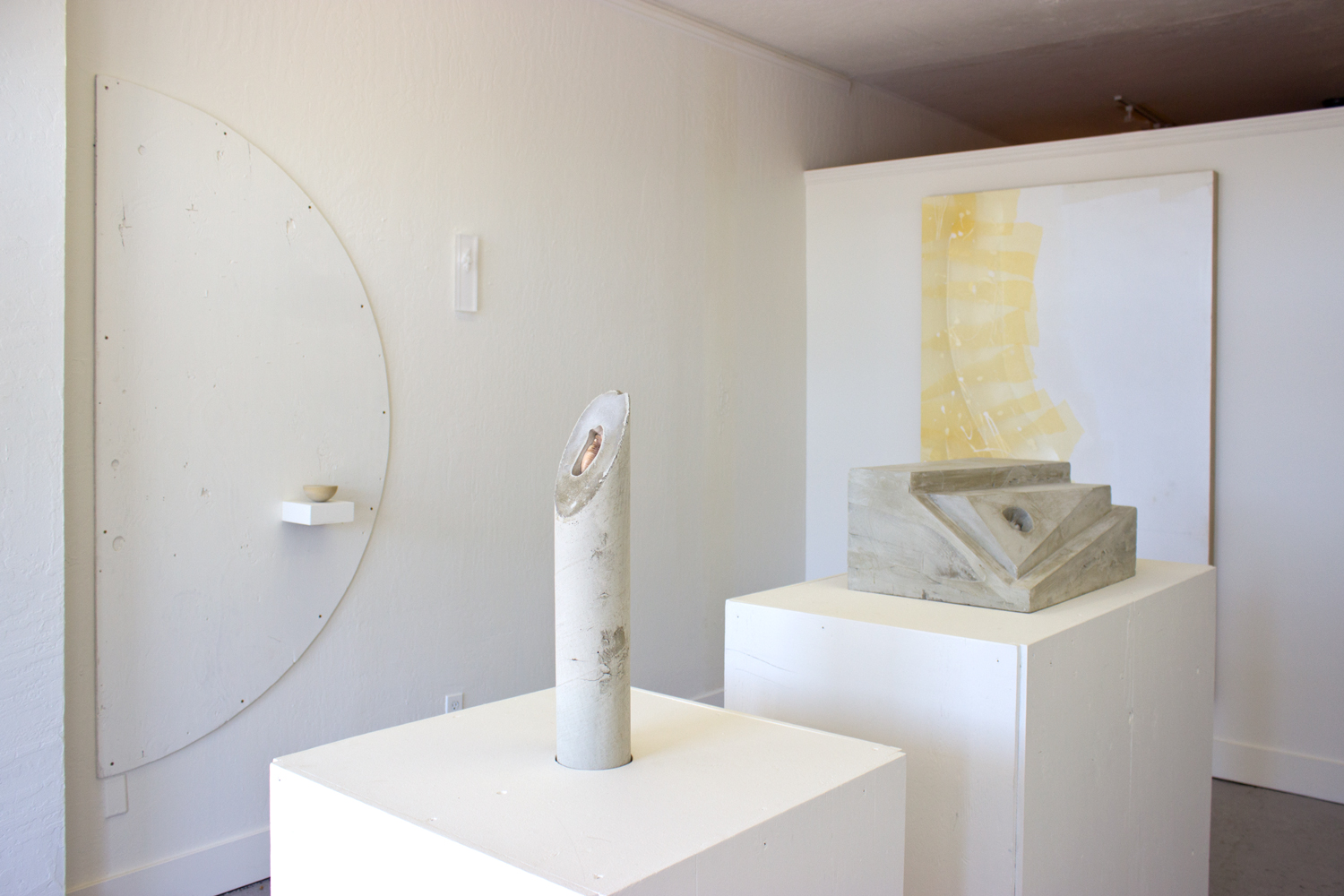 Custom Built-In   2015  Installation view (Untitled (concrete shell, cylinder) and Untitled (concrete shell, rectangle) shown in foreground)