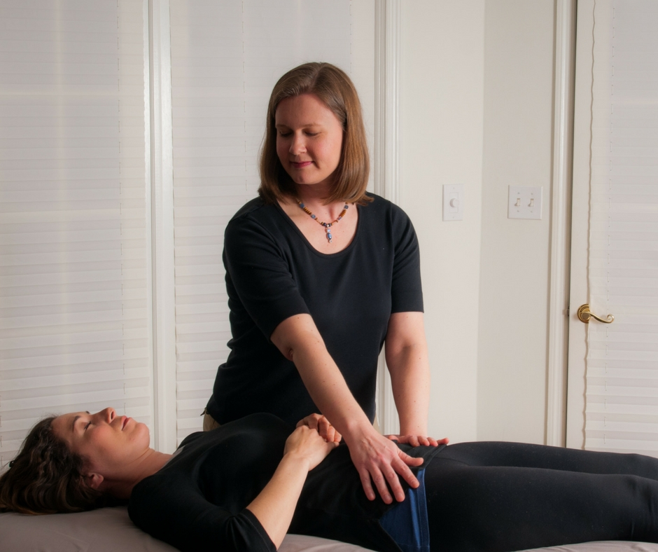 Maija Salins, LMT, CST-D, of Wise Bodymind in greater Atlanta, Georgia, works with a client during a CranioSacral Therapy session.