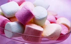 I love marshmallows and wouldn't mind sleeping on a bed made out of them or playing with them in bed.
