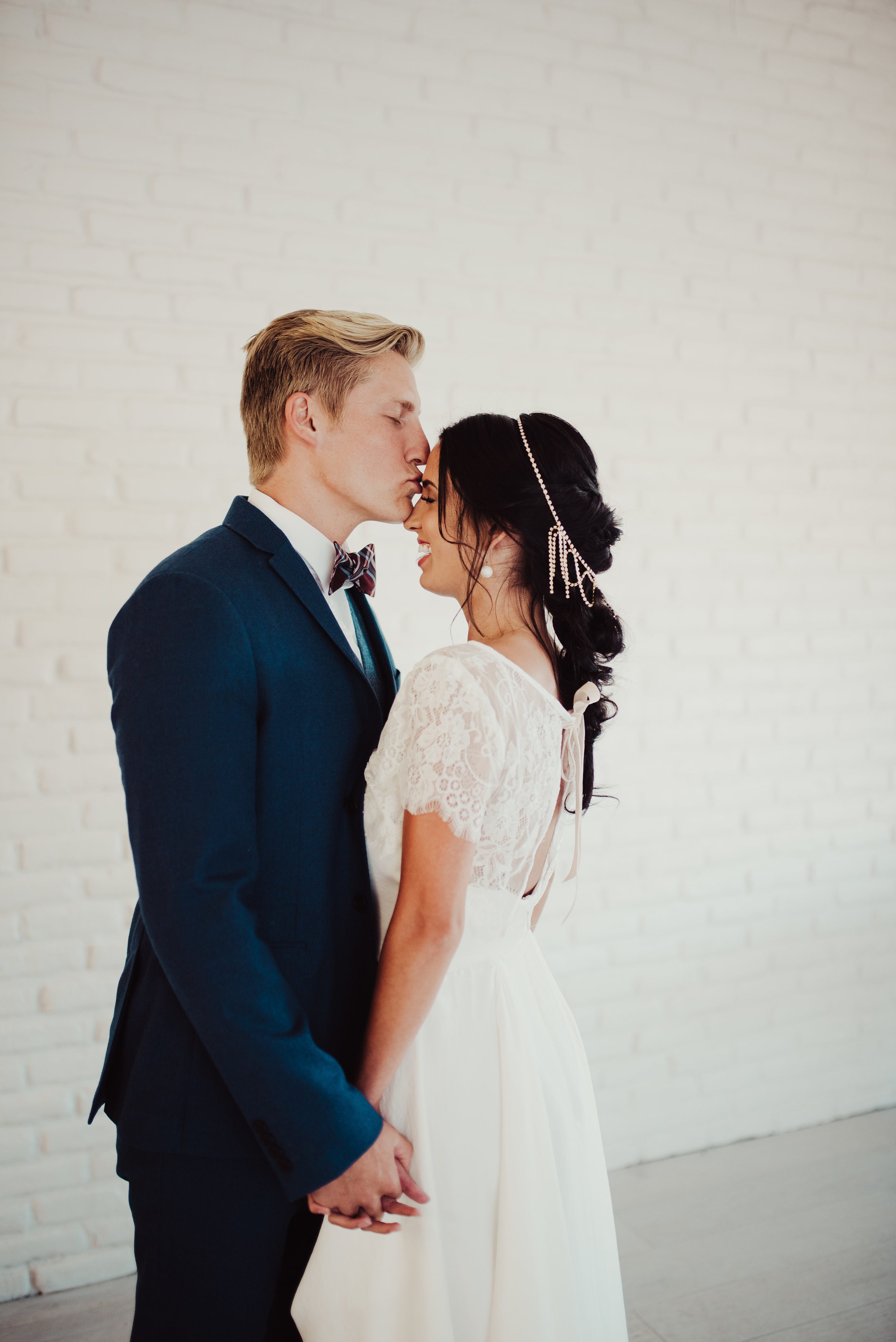 boho-bride-forhead-kiss.jpg