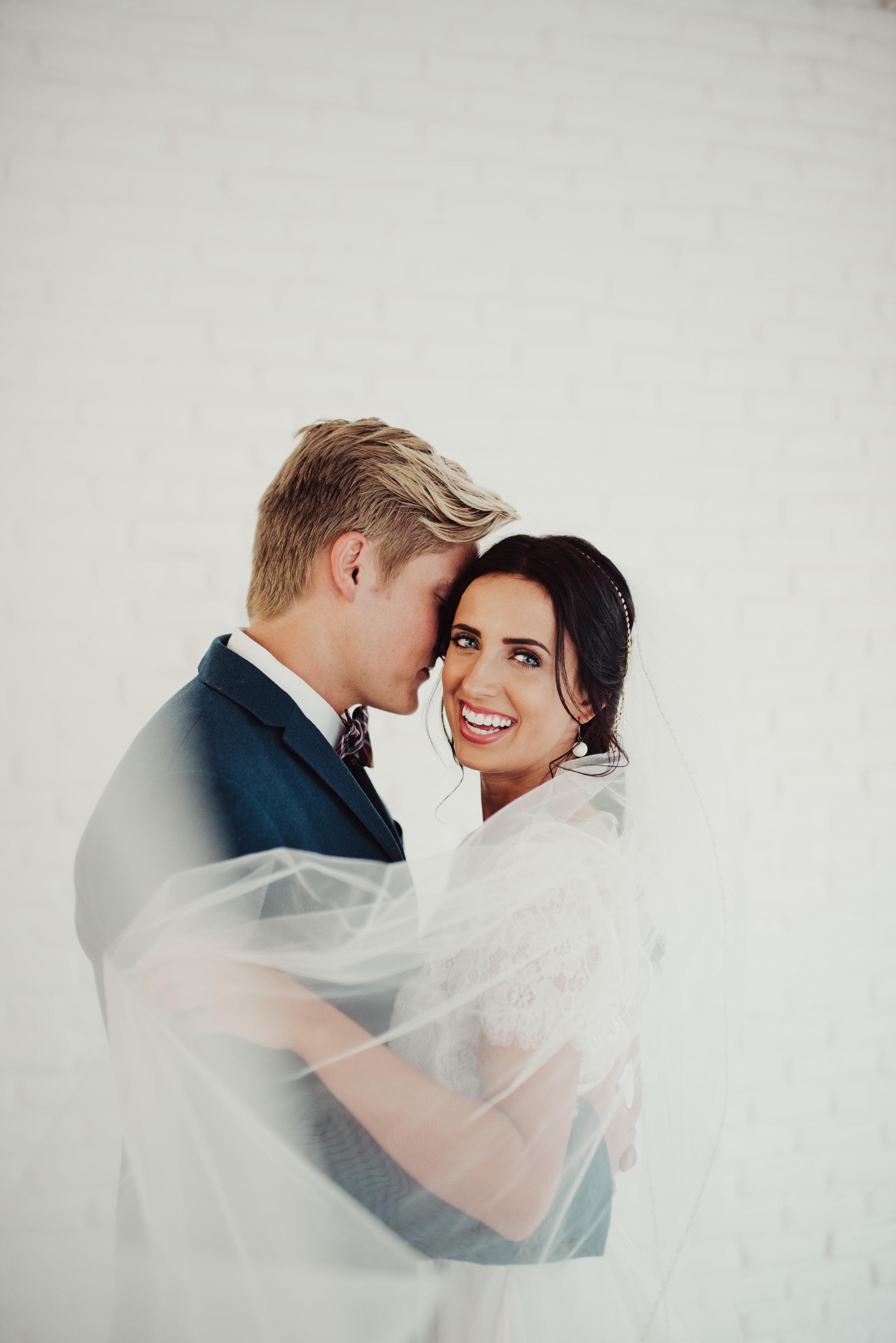 bride-and-groom-under-veil.jpg