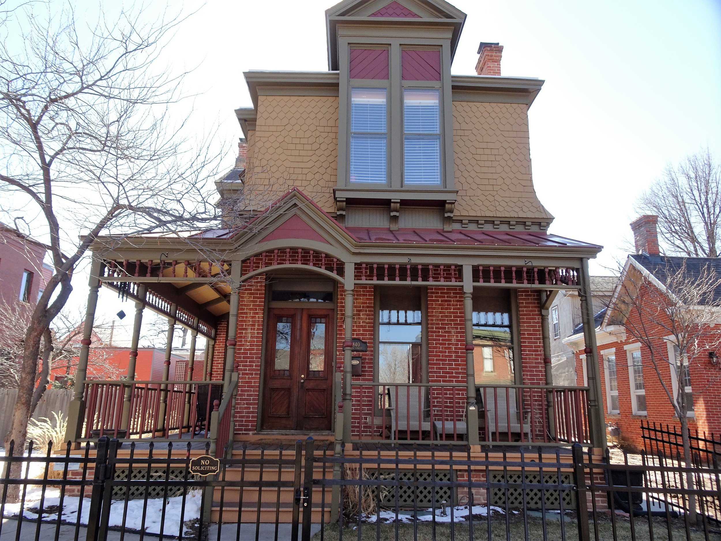 Second Empire - Beginning in the 1850s, and characterized by its distinctive mansard roof, and also typically hooded windows and a wide roof cornice.