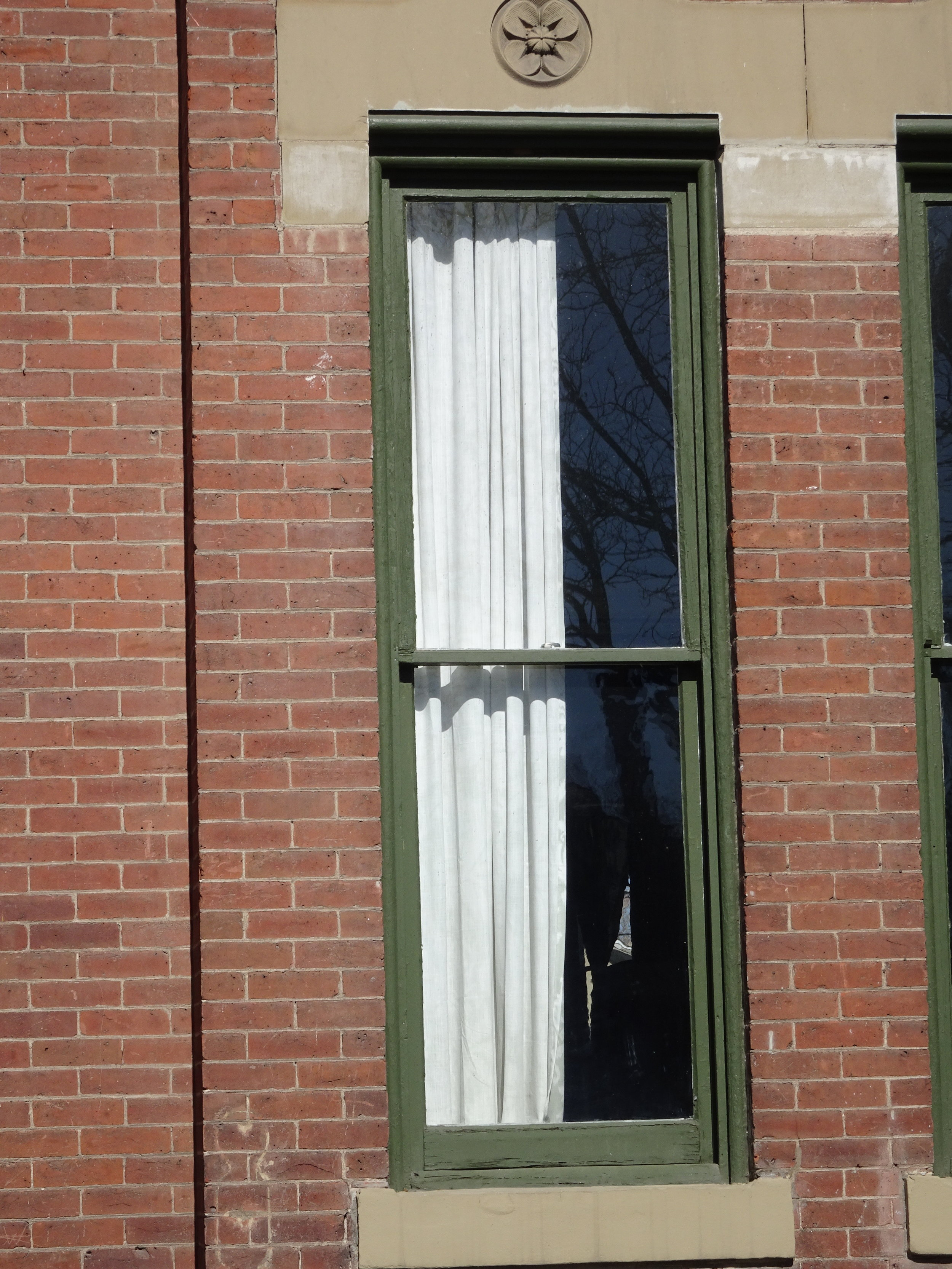 Most windows are simple, with a single pane of glass in the upper and lower sashes.