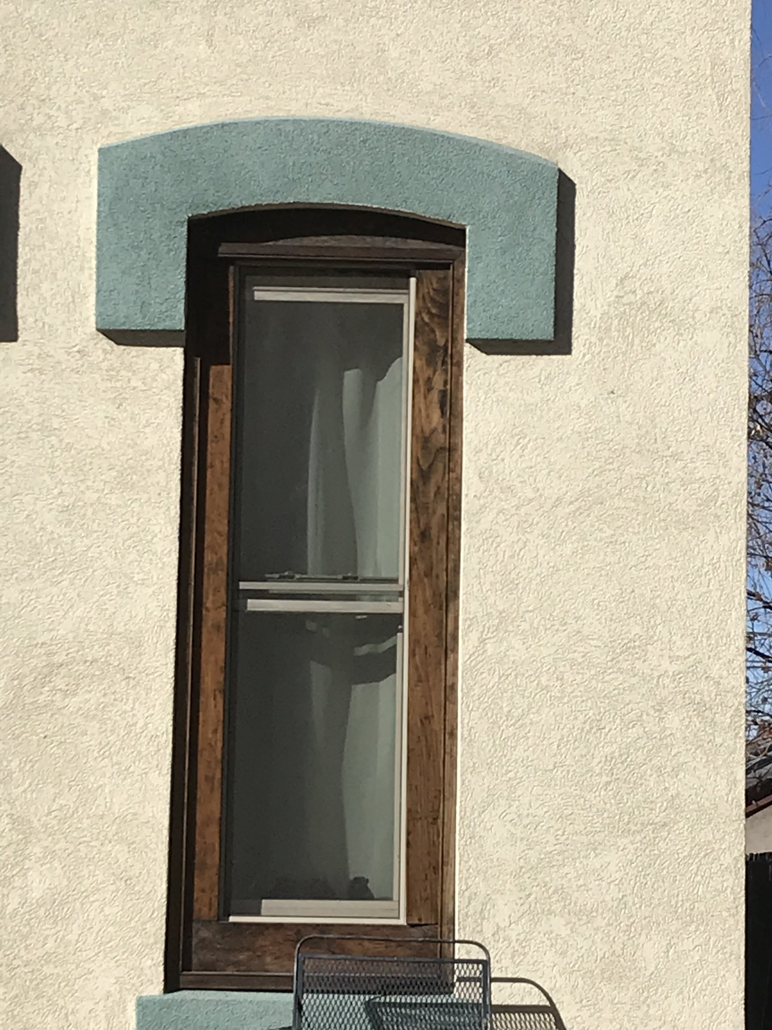 Replacement windows that are downsized from the original opening size detract from the building's historic architecture.