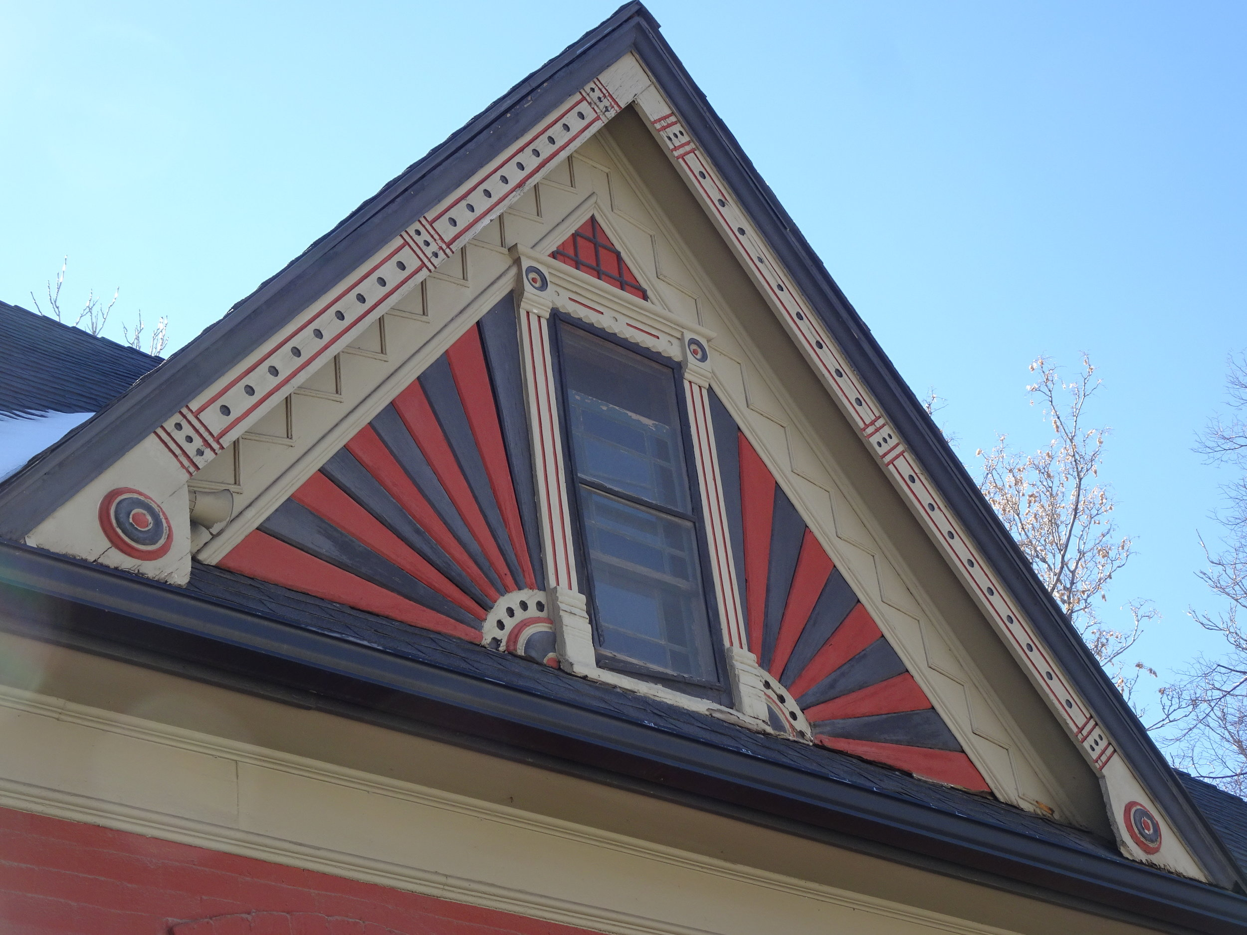 Keep gable end trim in good repair since it adds character and charm to a historic home.