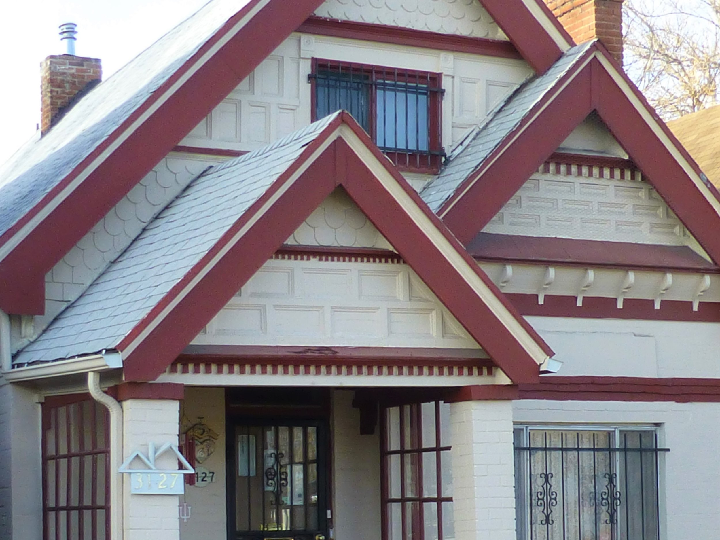 Patterned wooden ornamentation on gable ends is a hallmark of the Queen Anne style house.