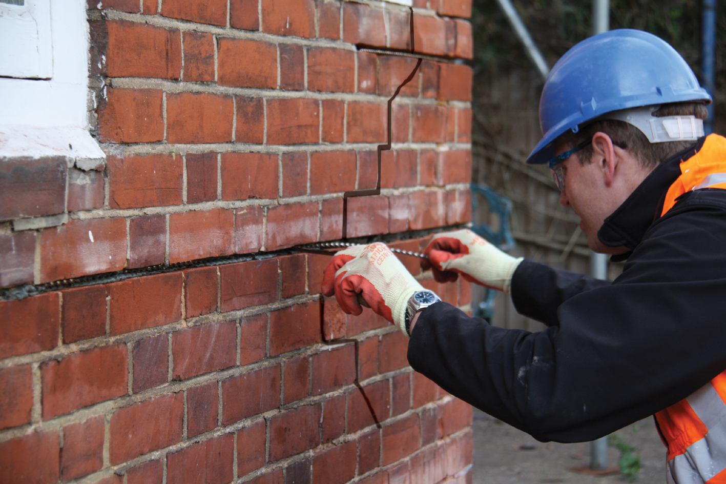 Maintaining Brick Exteriors - Exterior walls, banding and raised patterning, window sills/lintels, chimneys, and foundations.