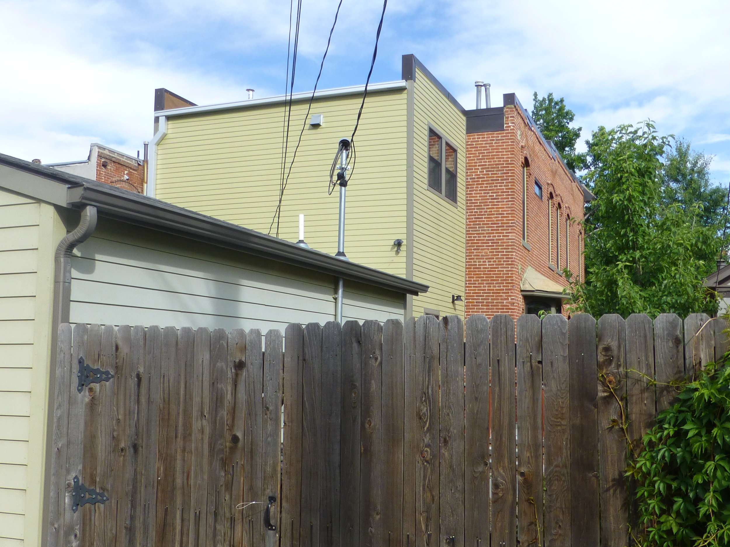 This rear addition is tucked in behind the historic house and is not visible from the street.