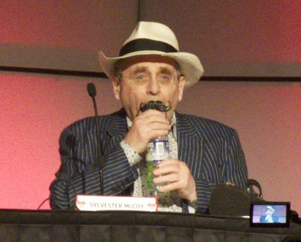 Sylvester McCoy with a mustache straw.