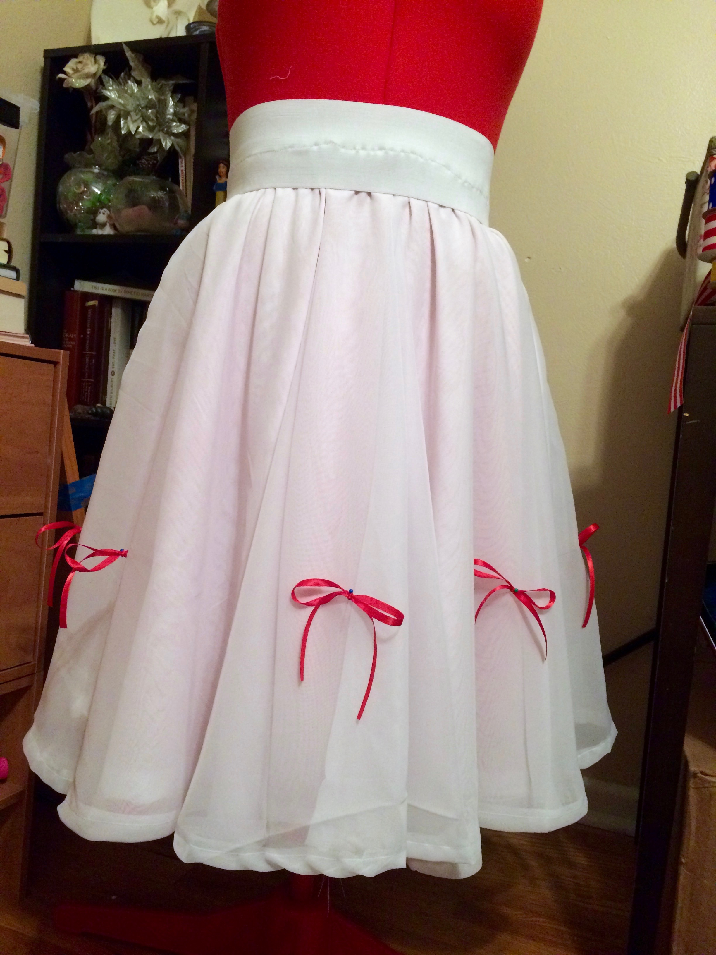 All the bows pinned in place, and the skirt is hemmed. The waist doesn't look fantastic, but won't be visible.