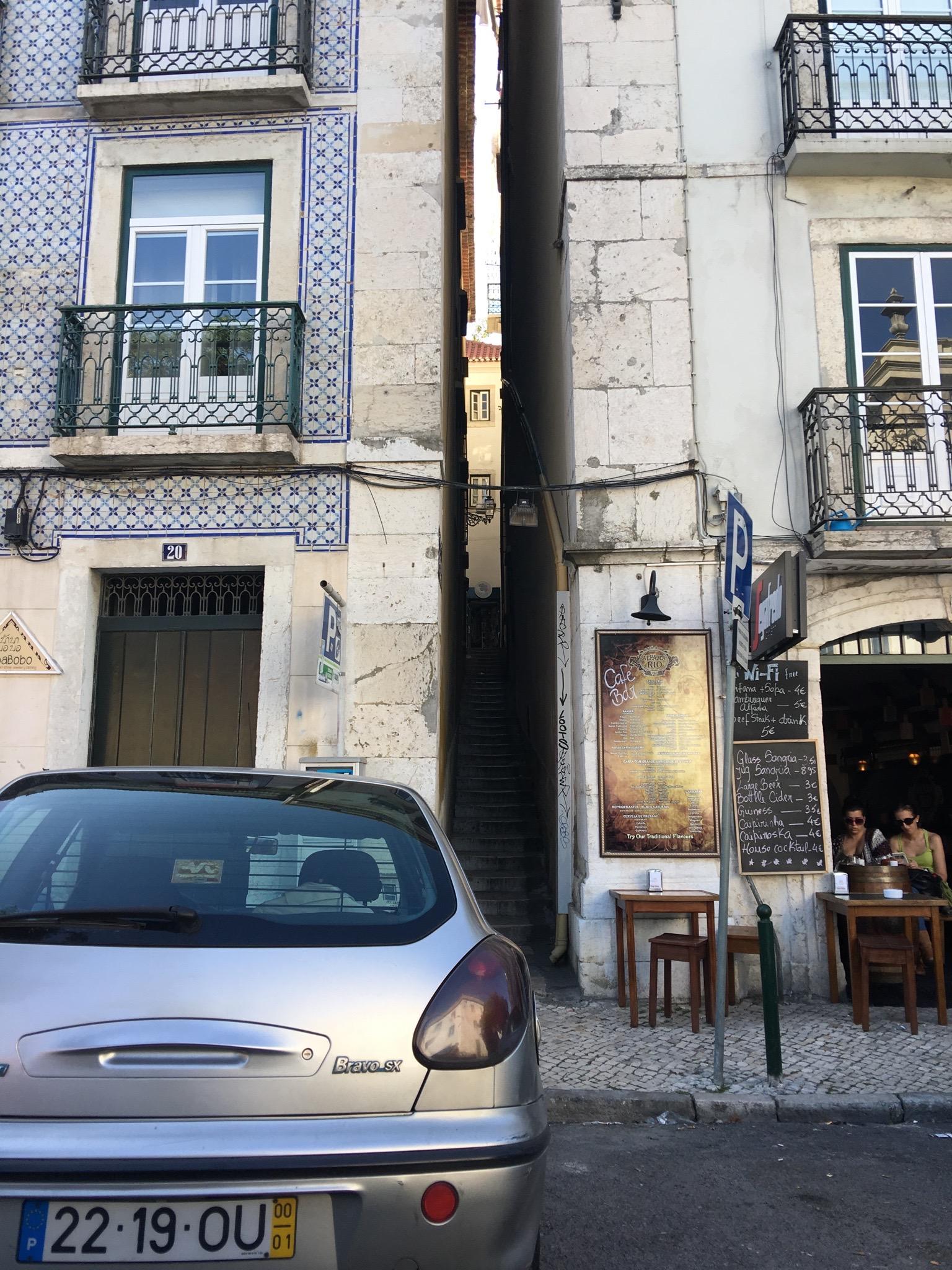 The narrowest street in Portugal, Escadinhas Do Terreiro Trigo , in the Alfama district