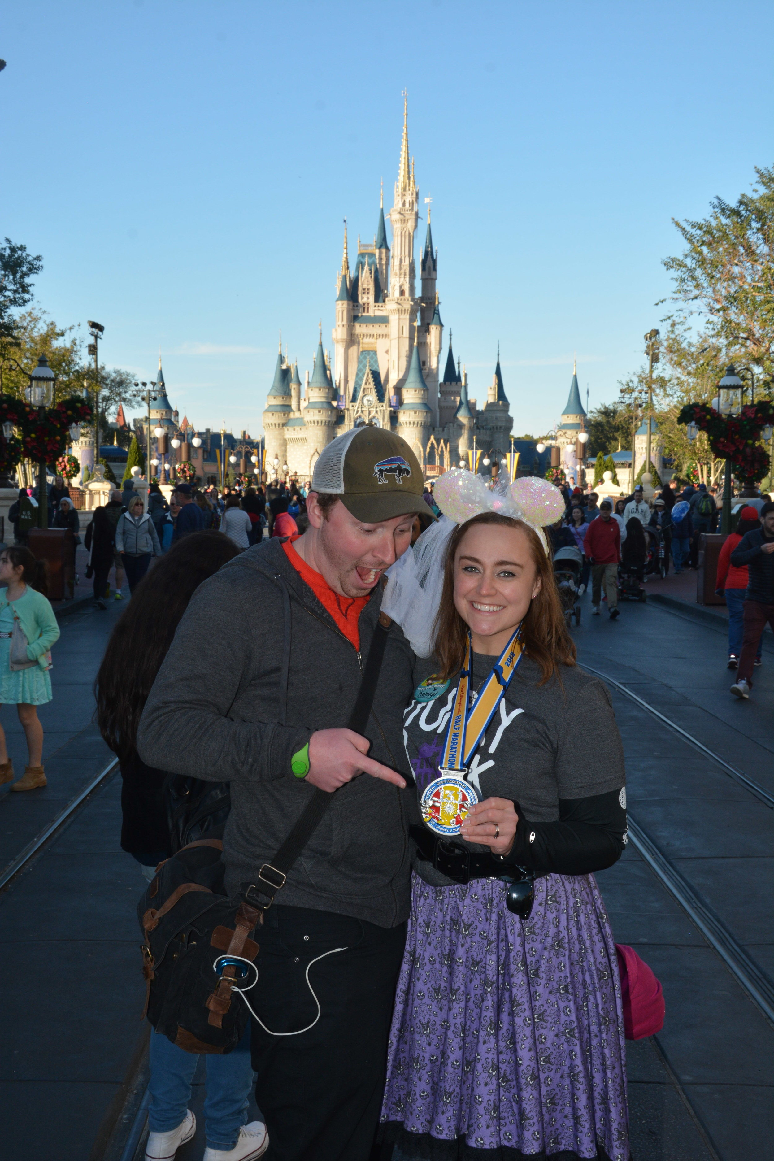 The greatest guy celebrating me finishing the race, even though I wear ridiculous homemade Haunted Mansion skirts