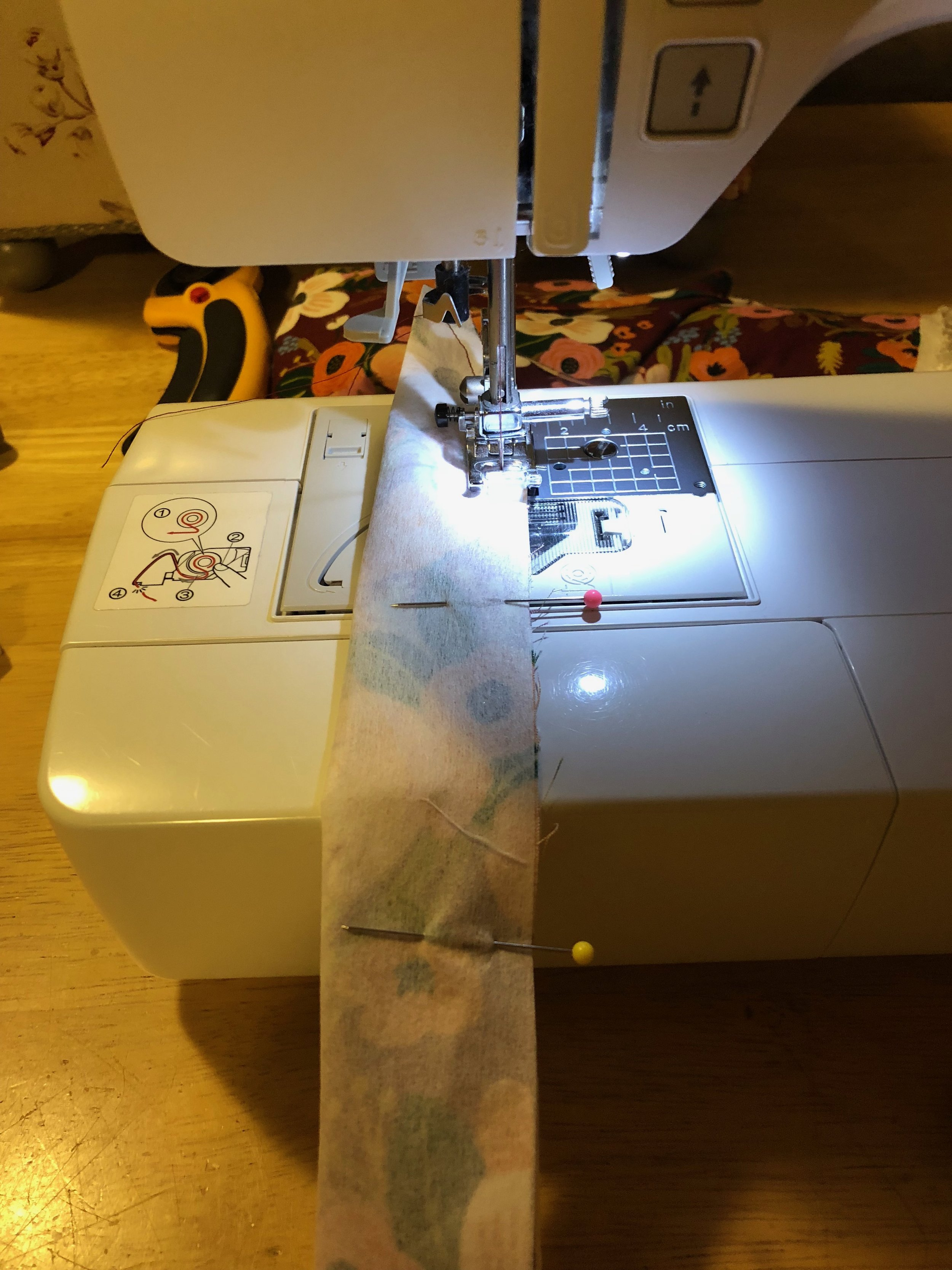 Sewing up the headband enclosure piece.