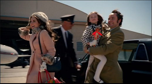Peter and his family getting on a plane for Kansas.