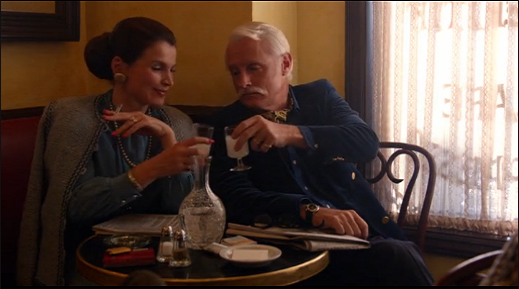 Roger and Marie enjoy a drink.