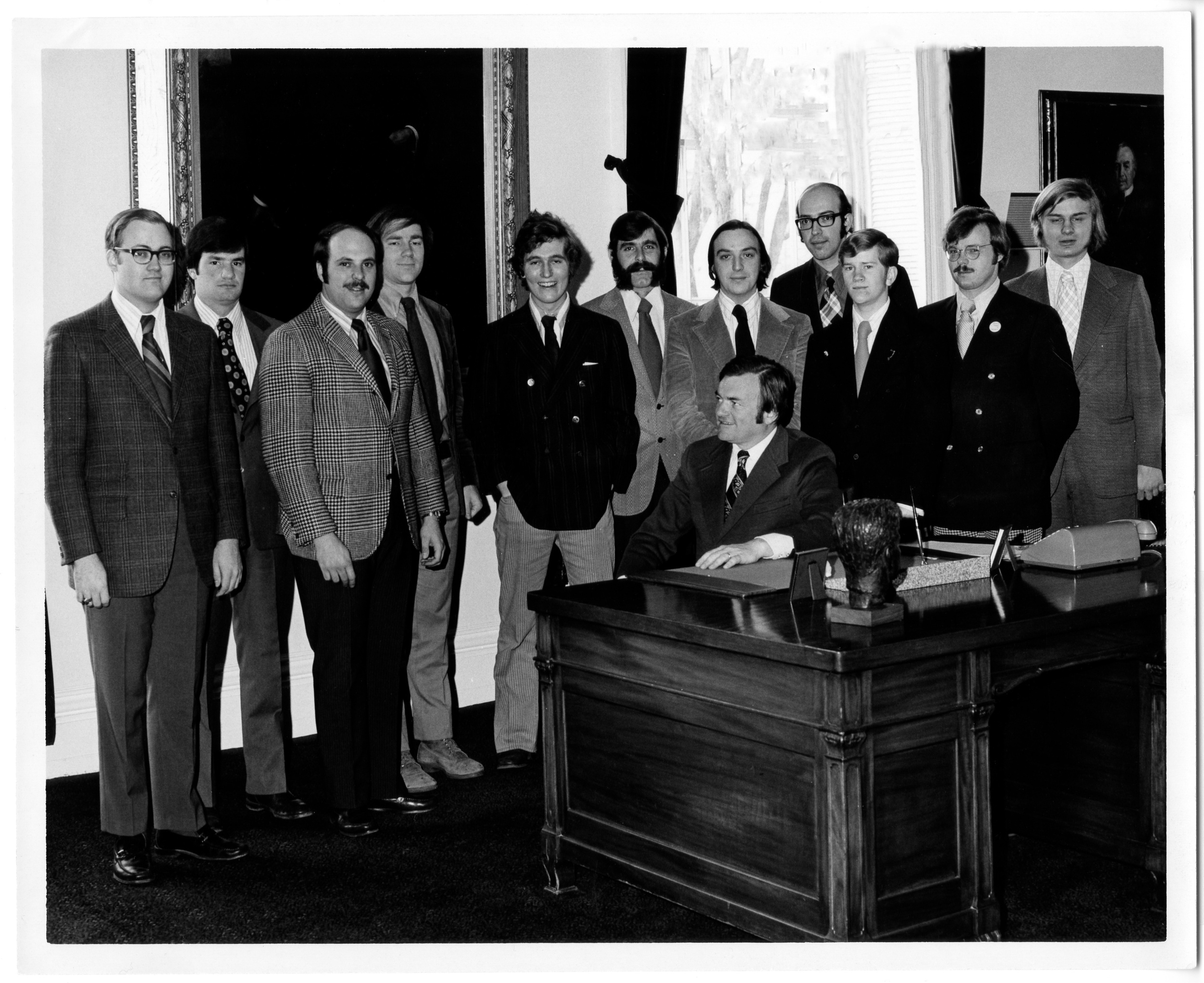 This is a picture of JD with Tom Salmon and other freshmen legislators under age 25 back in 1973.