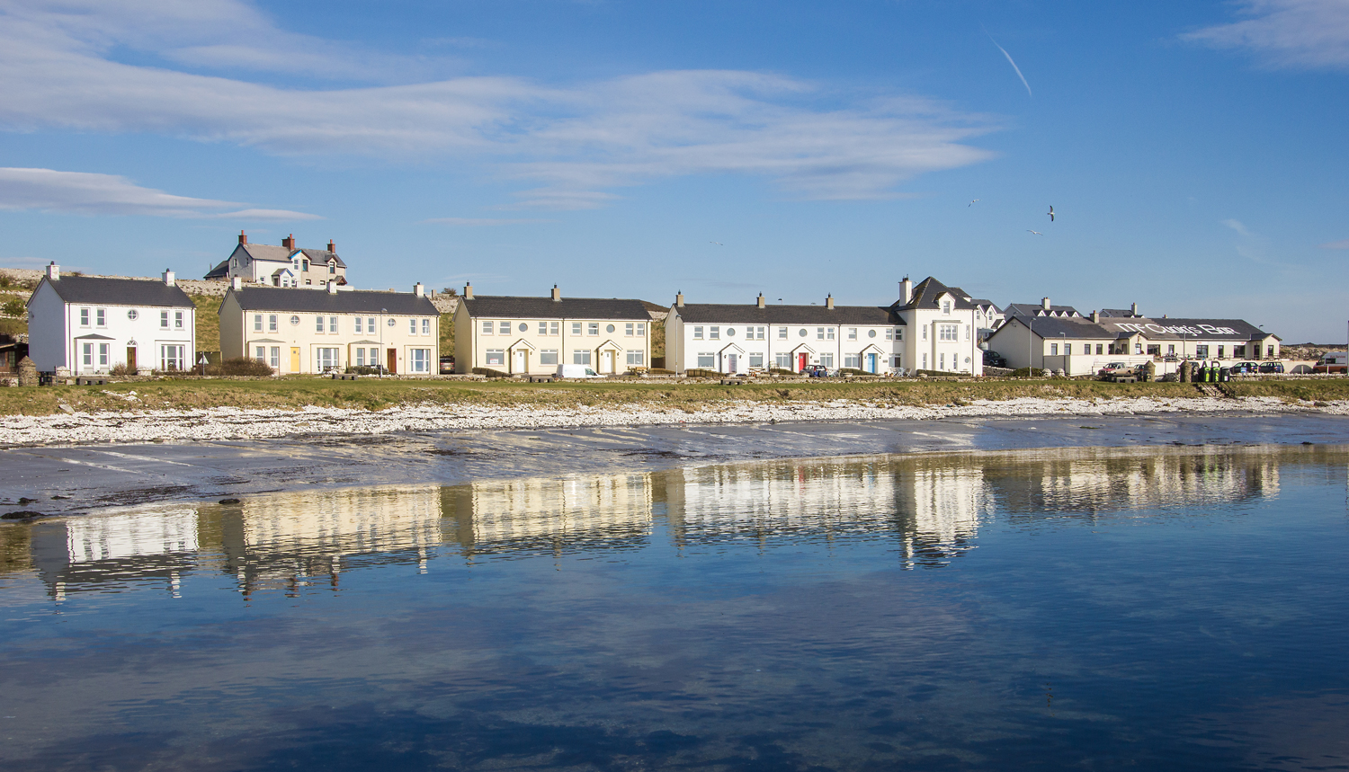 Reflections of Rathlin's cottages and the village pub, McCuaig's.