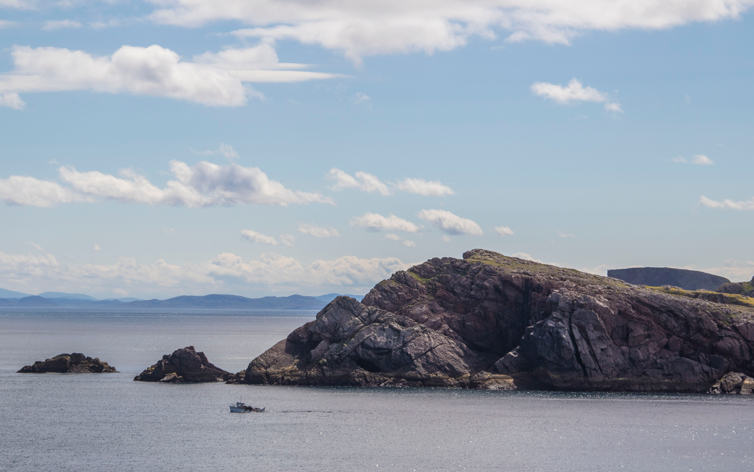 Mearnaid Rock by day. Mainland Donegal can be seen in the far distance.