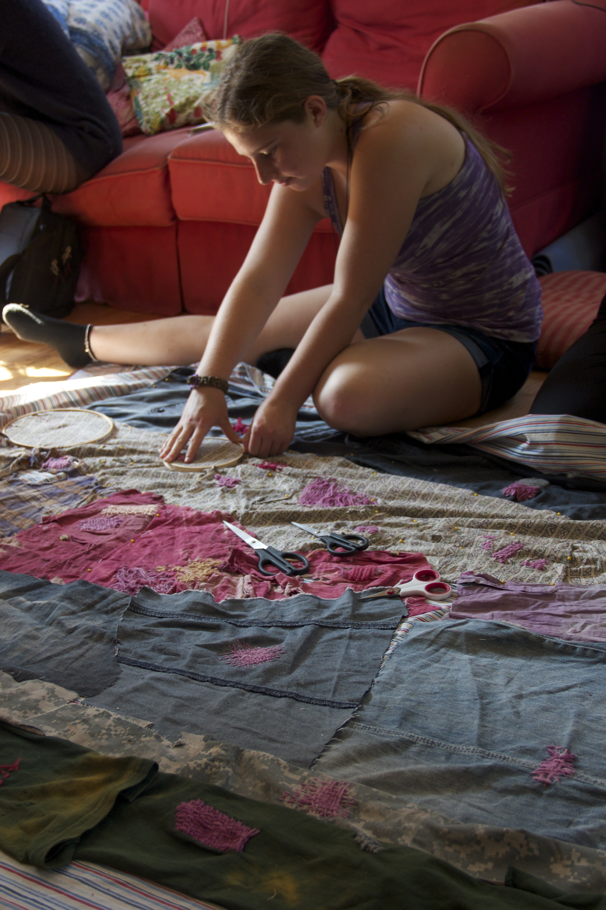 mending and stitching on the quilt for mending patriotism