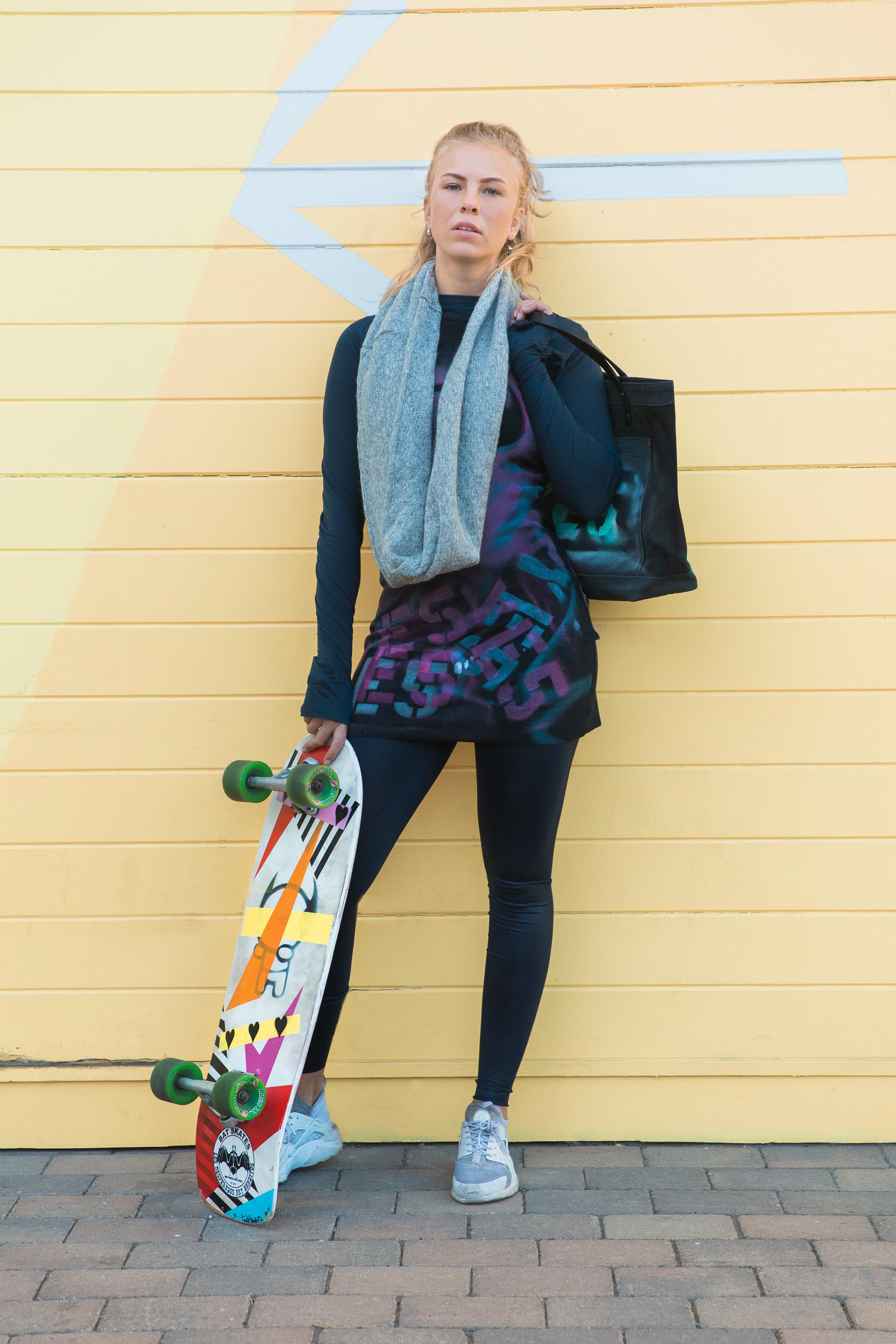 Long sleeve cashmere crewneck shirt ($130), high-rise liquid leggings in navy ($96), racerback rib dress ($268), Lux Infinity scarf ($50), Black Chester Wallace bag ($250), Torquato skateboard ($450)