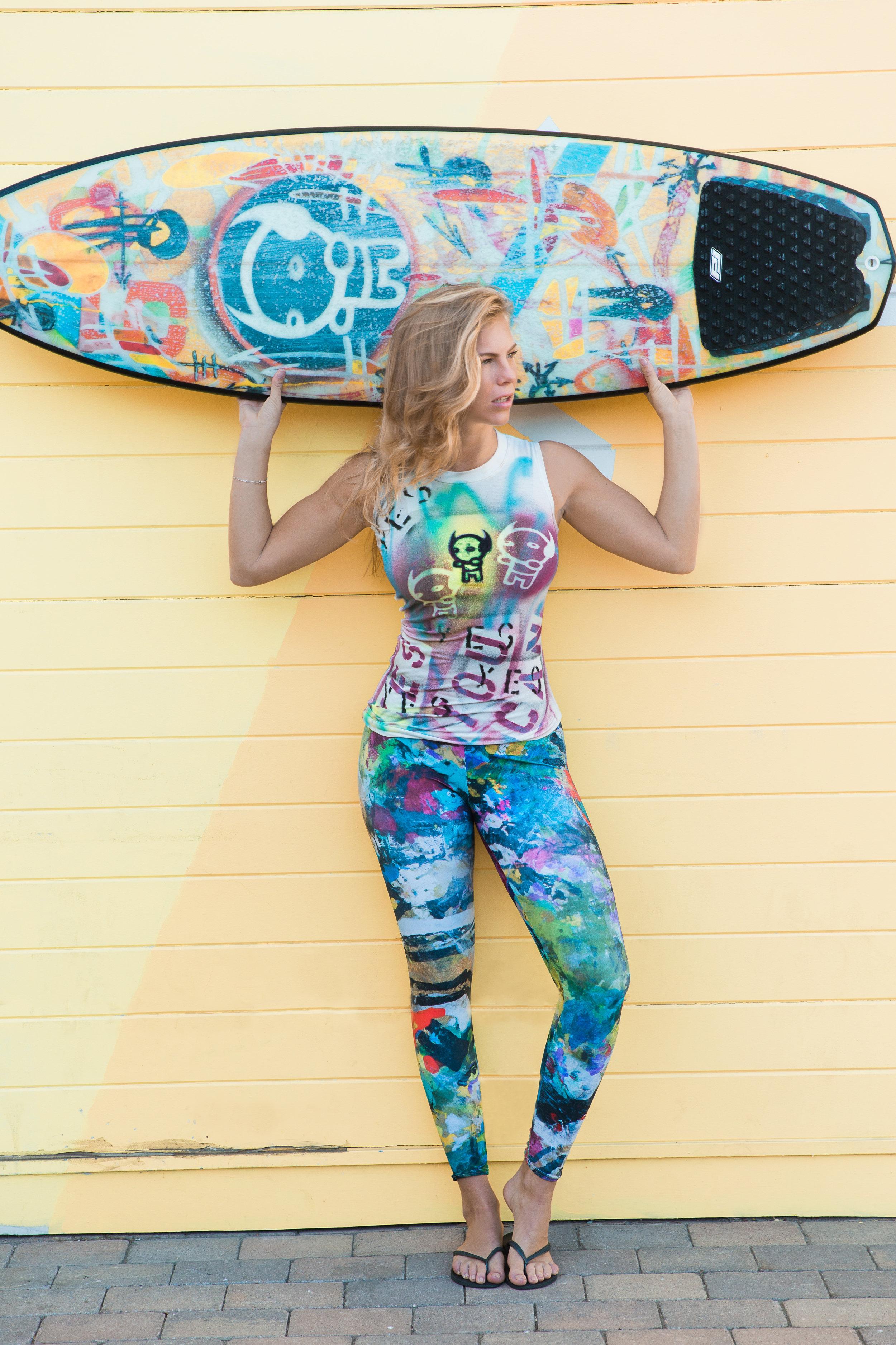 White muscle T-shirt ($269), Sumatra Reef leggings ($125), Torquato surfboard ($7,500)