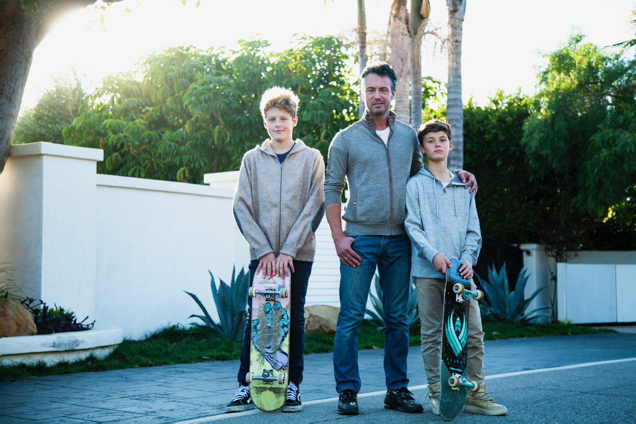Daniel Adams and his two sons Emilio and Tassilo on Broad Beach Road.  Photo by Isak Tiner