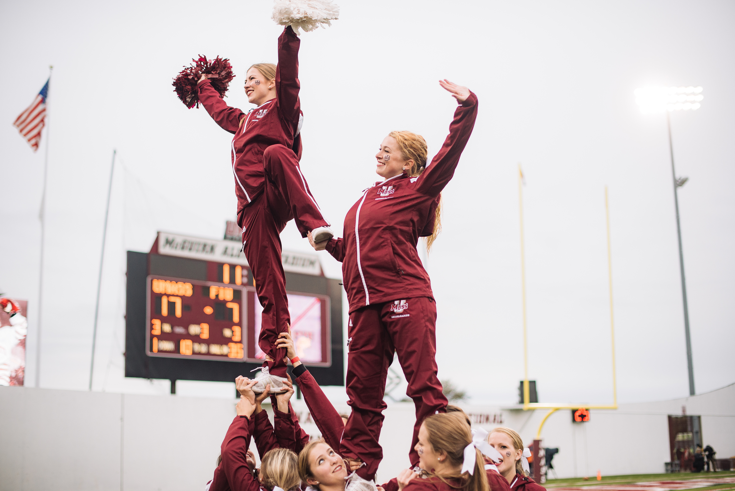 UMass Cheerleaders at a football game. Photo by Judith Gibson-Okunieff