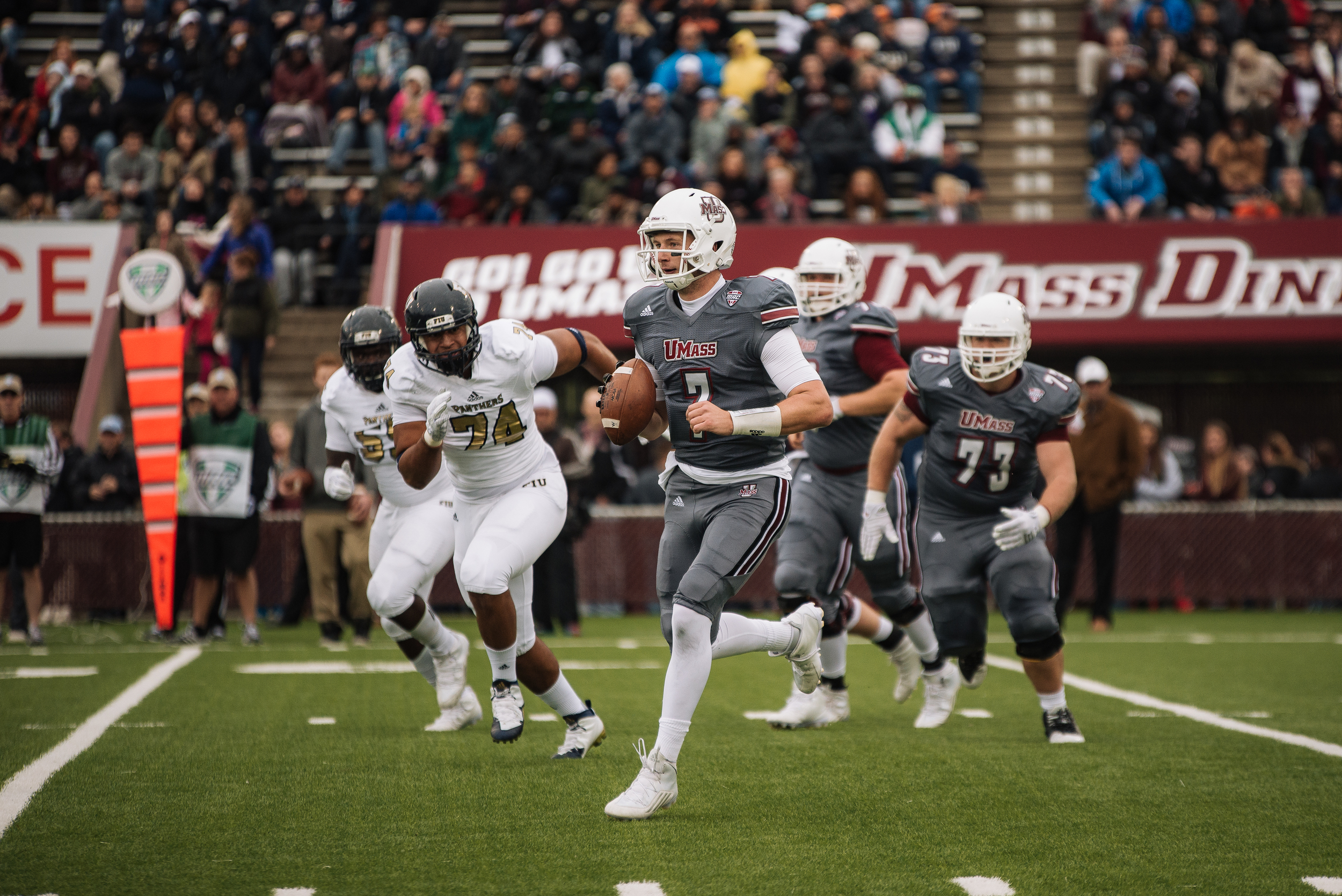 UMass QB Blake Frohnapfel carries the ball. Photo by Judith Gibson-Okunieff