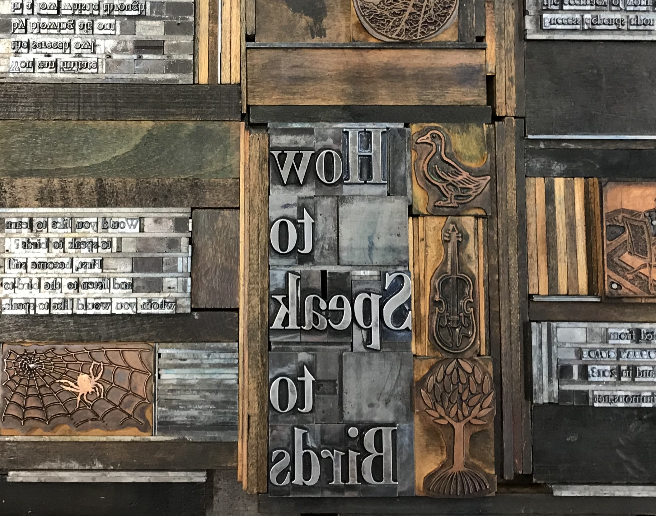 "Typesetting for ""How to Speak to Birds"" in the letterpress studio at Penland's Winter Residency, 2018, photo by Rachel Simmons"