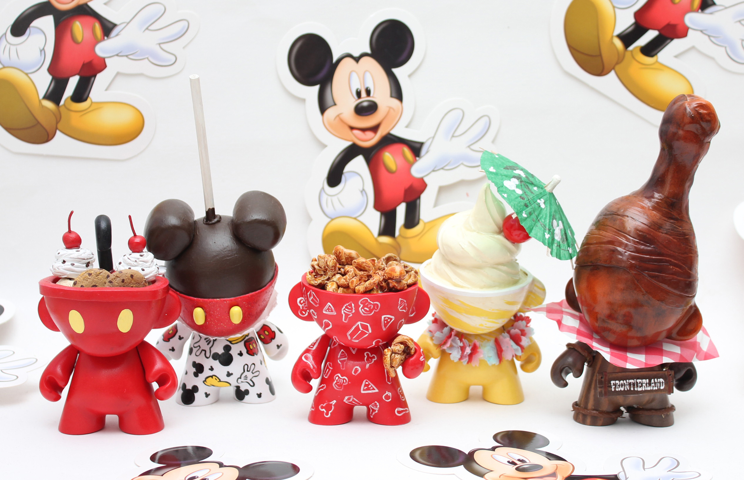 (L-R) Mickey Kitchen Sink Sundae,  Mickey Candy Apple, Caramel Corn, Dole Whip, and Turkey Leg