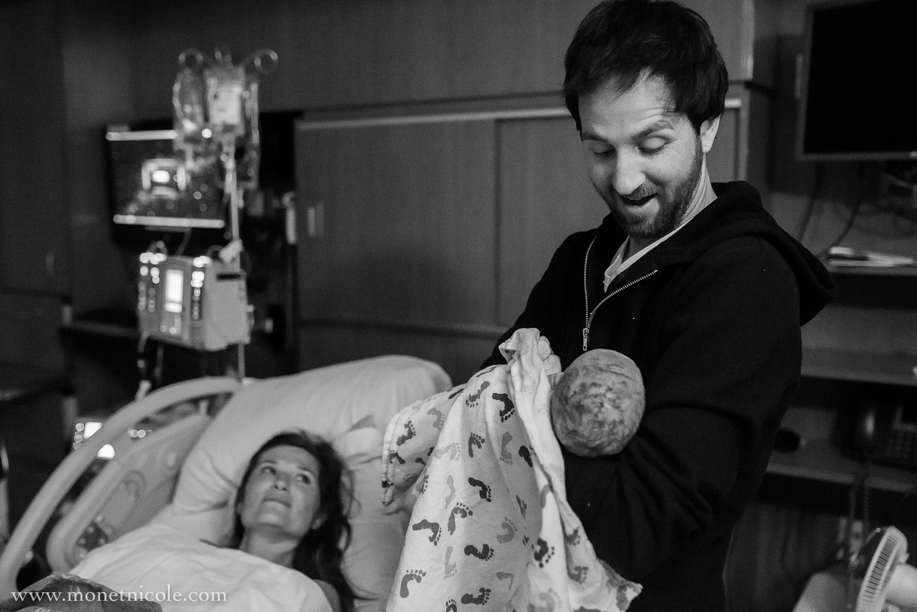 denver-birth-photography-hospital-birth-jace-father-holds-baby