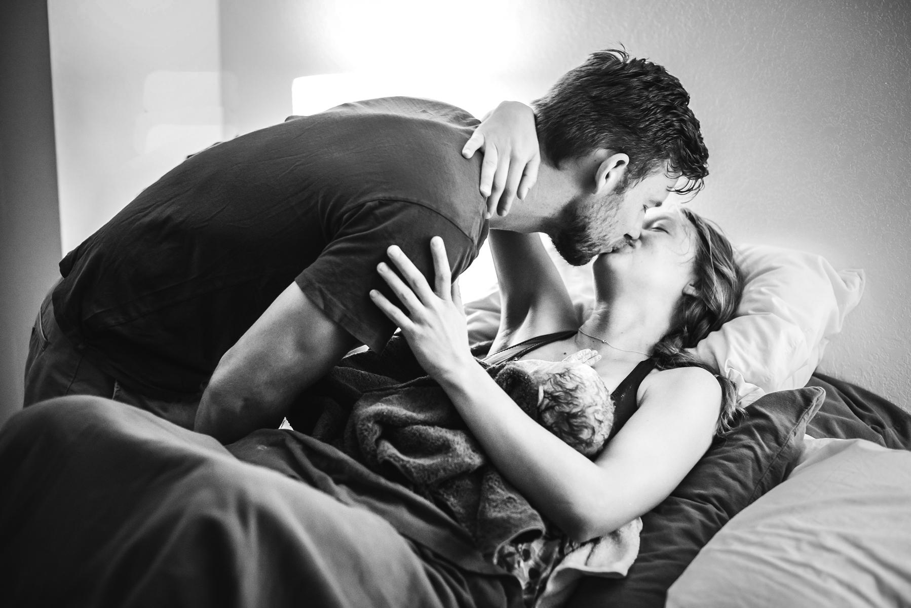 Colorado-springs-birth-photographer-home-birth-couple-embraces