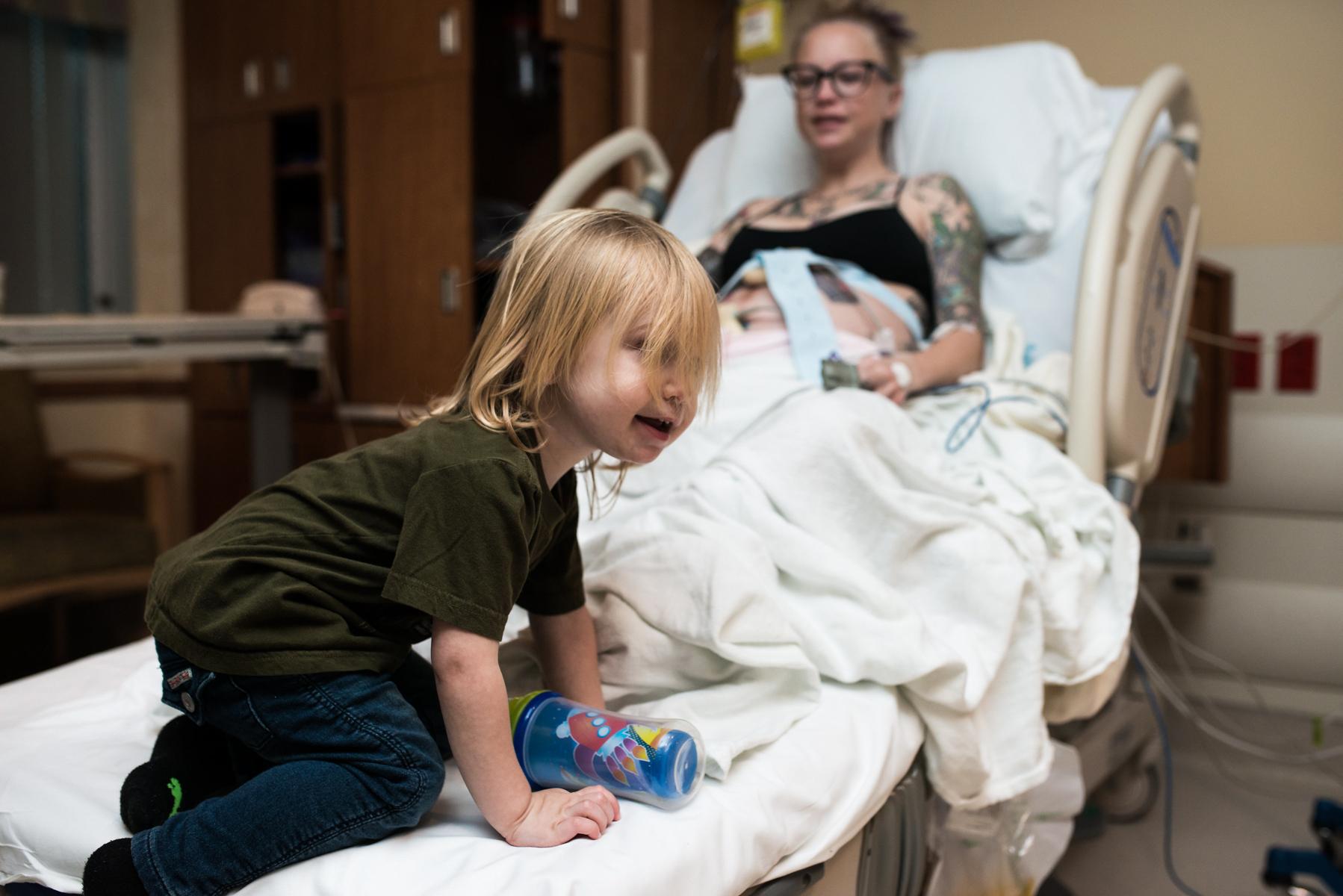 denver-birth-photographer-older-sibling-plays