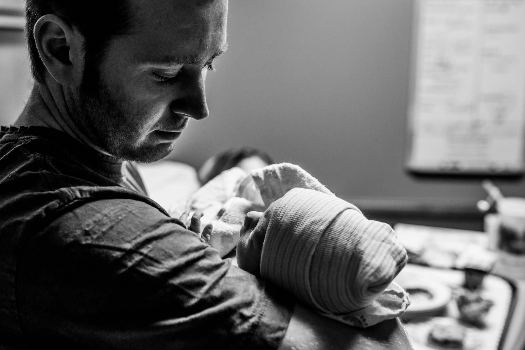 lutheran-medical-center-birth-photography-dad-holds-baby
