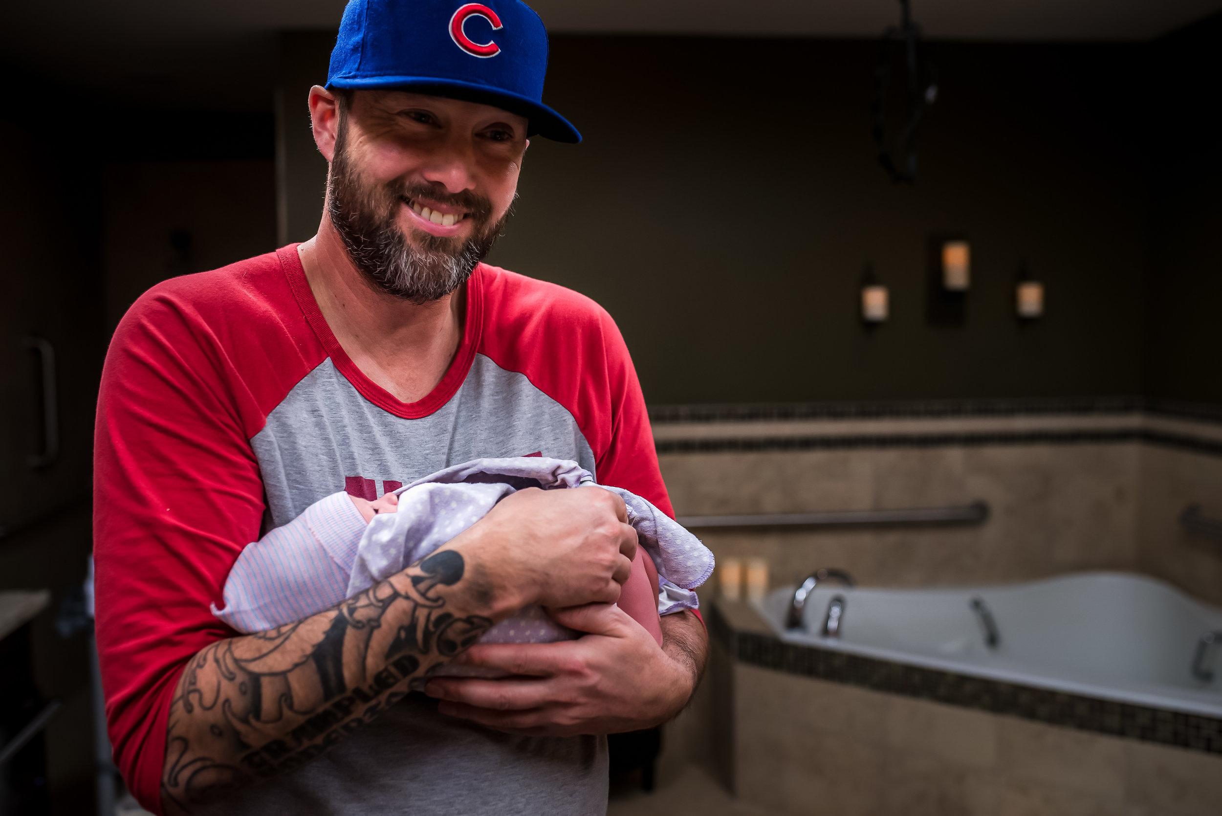 Monet-Nicole-Birth-Photographer-Dad-Holds-Baby