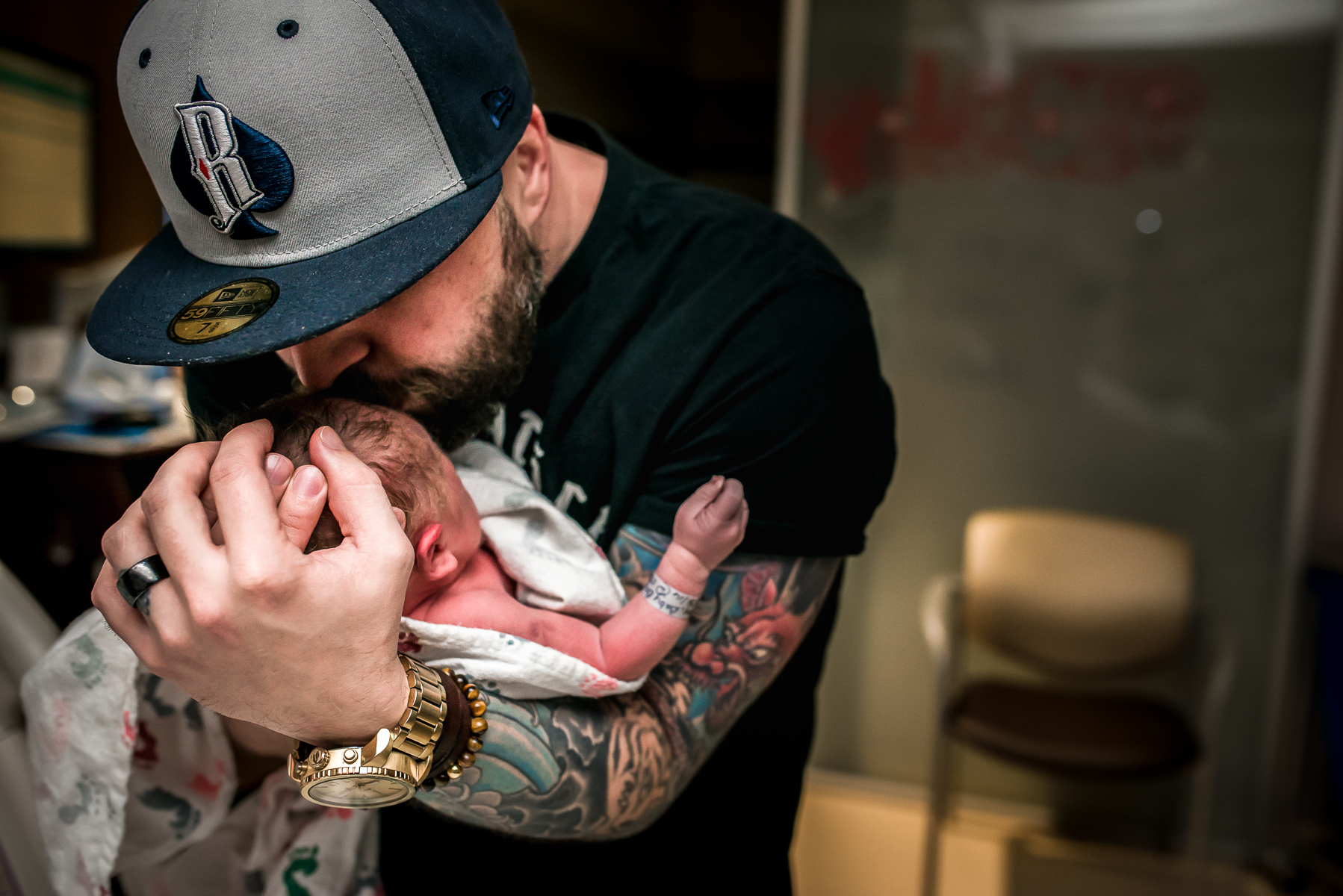 Dad-Kisses-Baby-Fort-Collins-Birth-Photographer