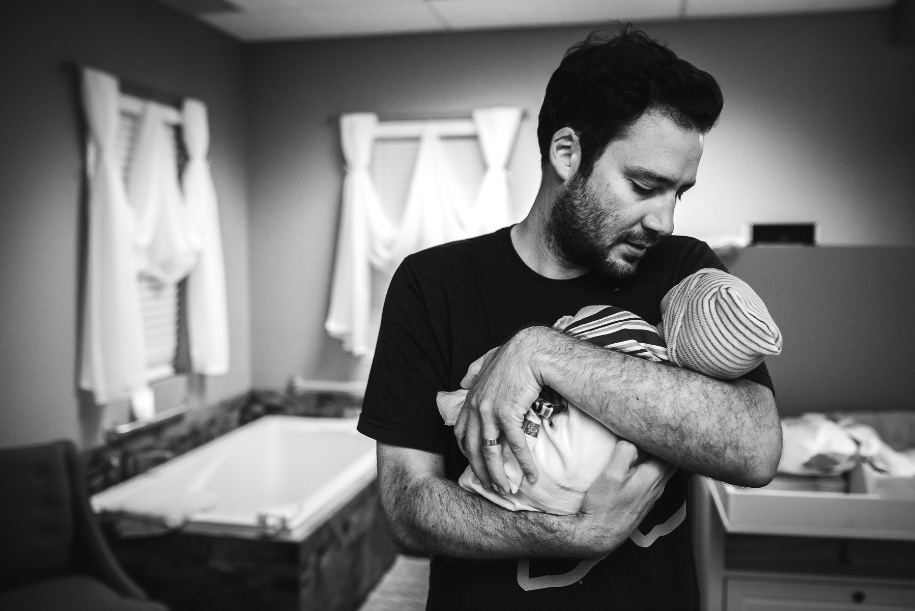 dad-holds-baby-first-time