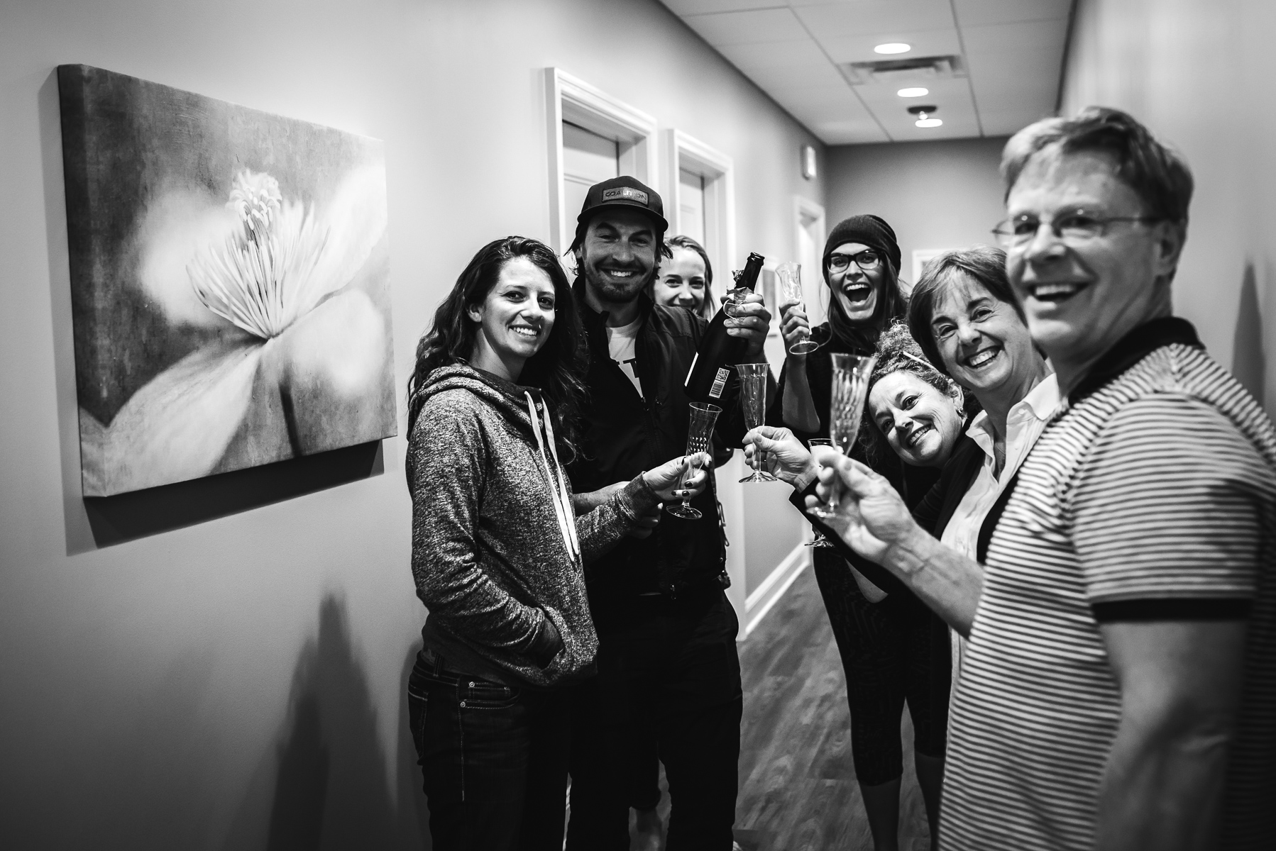 family-toasts-in-hall-after-birth