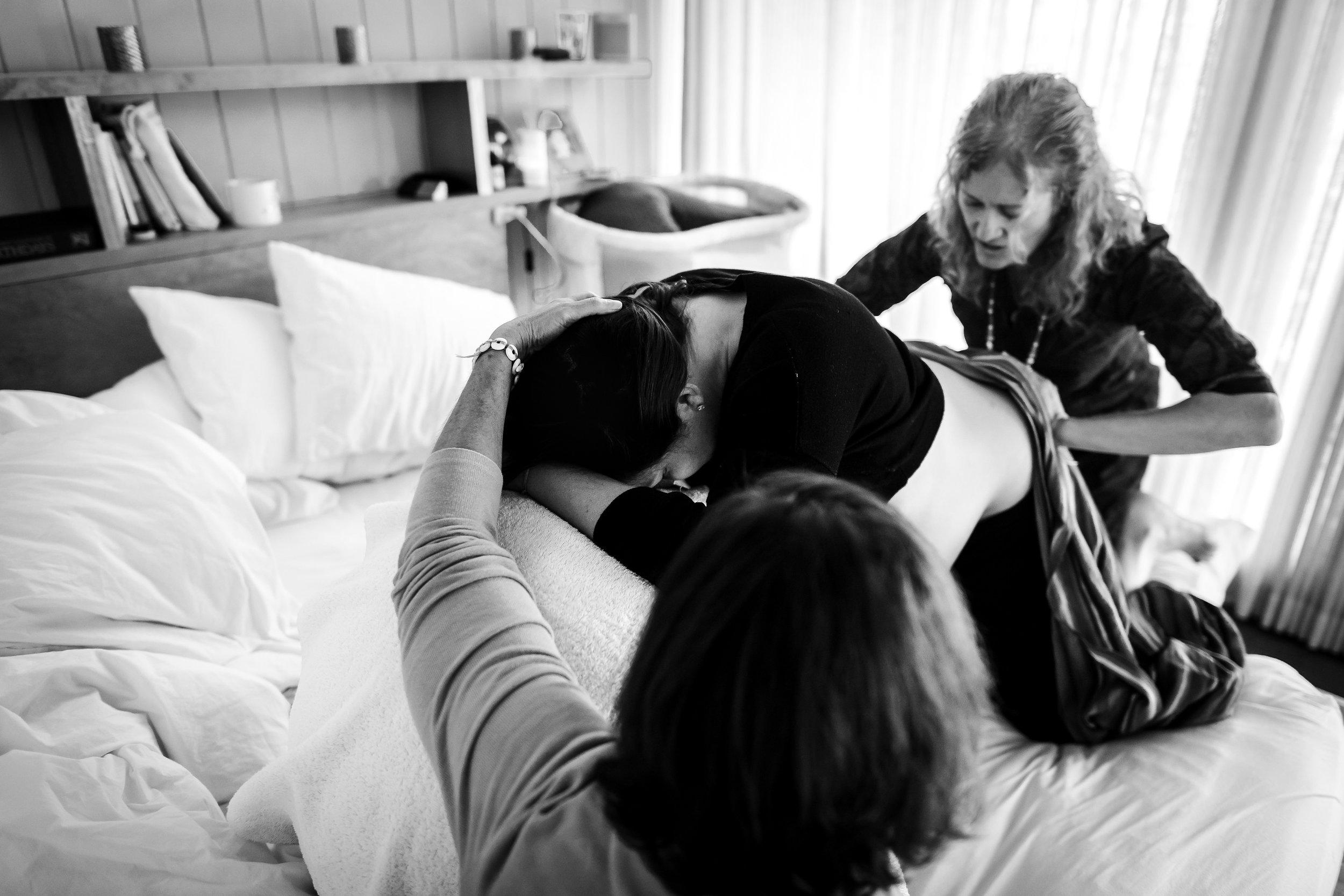 Denver-homebirth-labor-on-bed